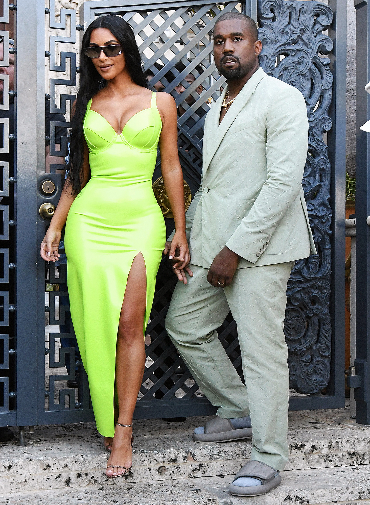 Kim Kardashian Kanye West 2 Chainz Wedding Ice Cream Date - The twosome made for a head-turning pair, with Kardashian, 37, in a neon green bodycon ensemble and West, 41, in a dapper gray Louis Vuitton suit and a pair of Yeezy slides.