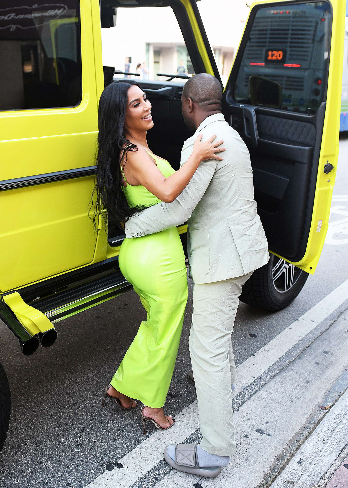 Kim Kardashian Kanye West 2 Chainz Wedding Ice Cream Date - The musician set his wife down gently as she beamed up at him.
