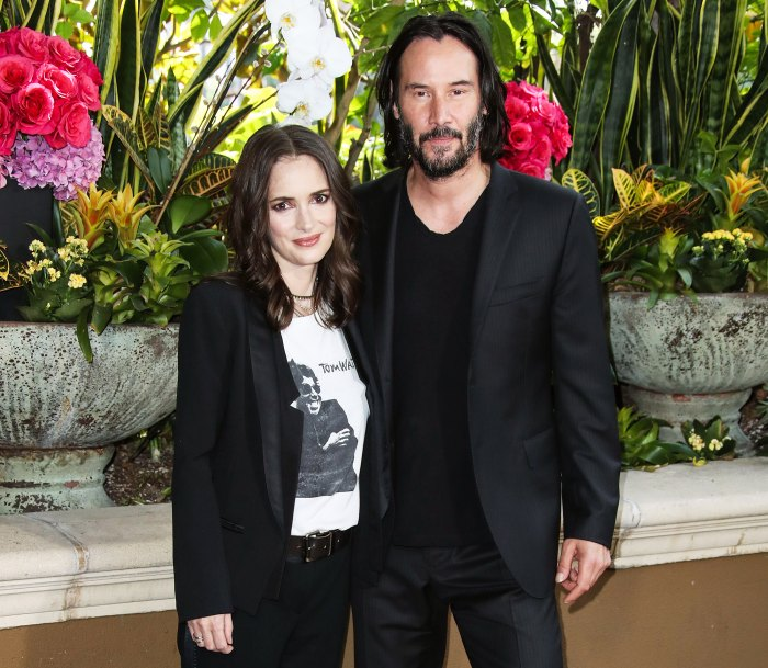 Winona Ryder and Keanu Reeves attend the photocall for 'Destination Wedding' held at the Four Seasons Hotel Los Angeles on August 18, 2018.