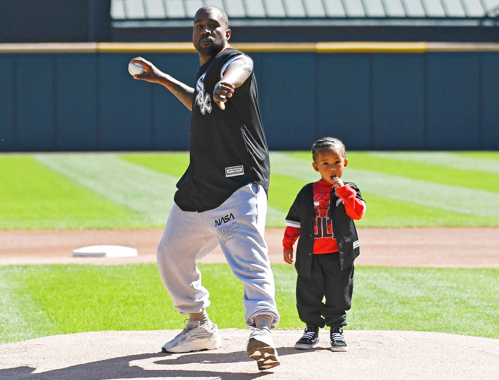 Kanye West, Saint West, First Pitch, Cubs, White Sox - Kanye West and his son Saint throw out a ceremonial first pitch before the game between the Chicago White Sox and the Chicago Cubs on September 23, 2018 at Guaranteed Rate Field in Chicago, Illinois.