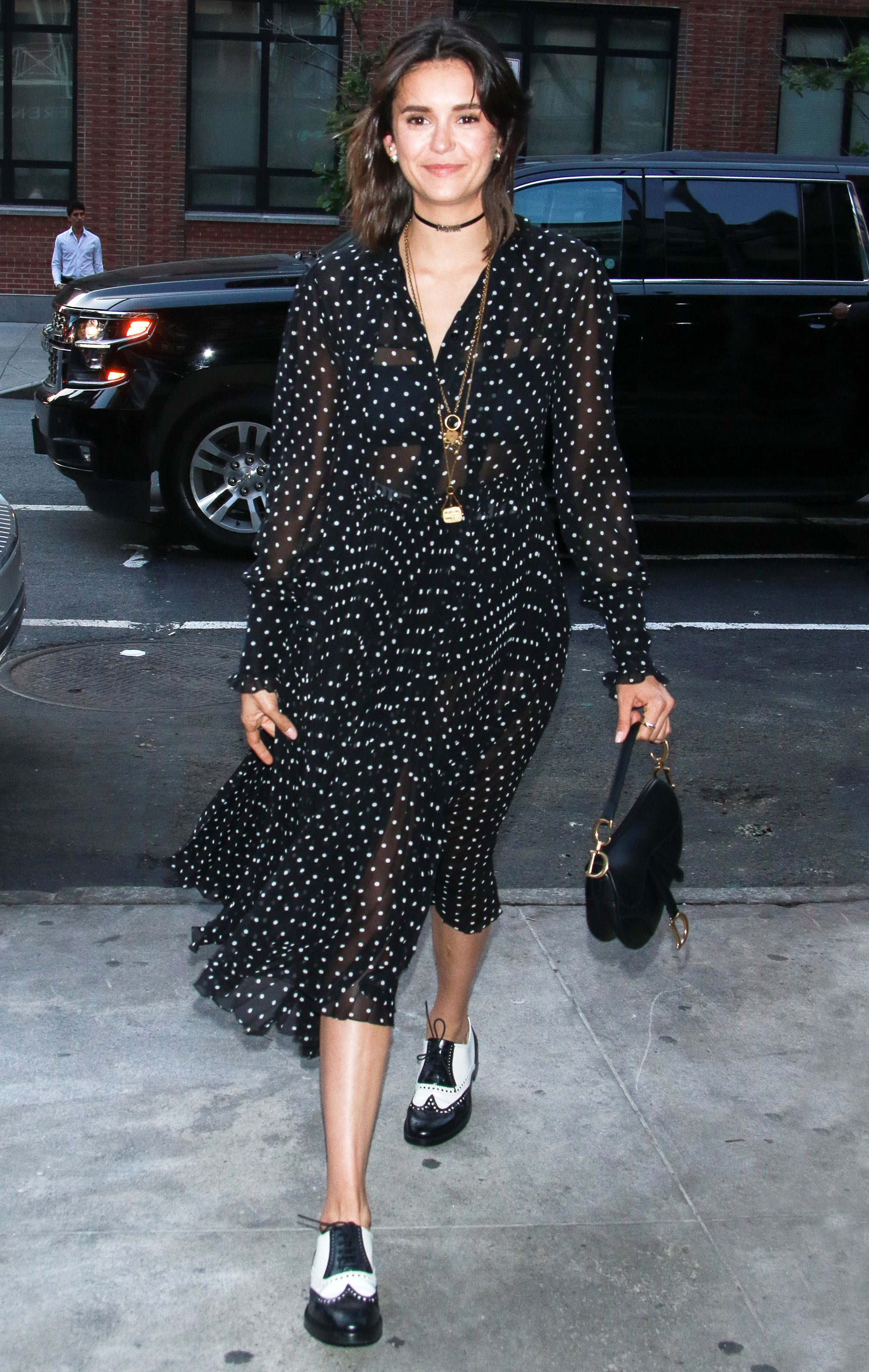 Nina Dobrev - The actress hit a June 7 Dior Beauty daytime event with a polka dot dress, two tone shoes and the iconic purse.
