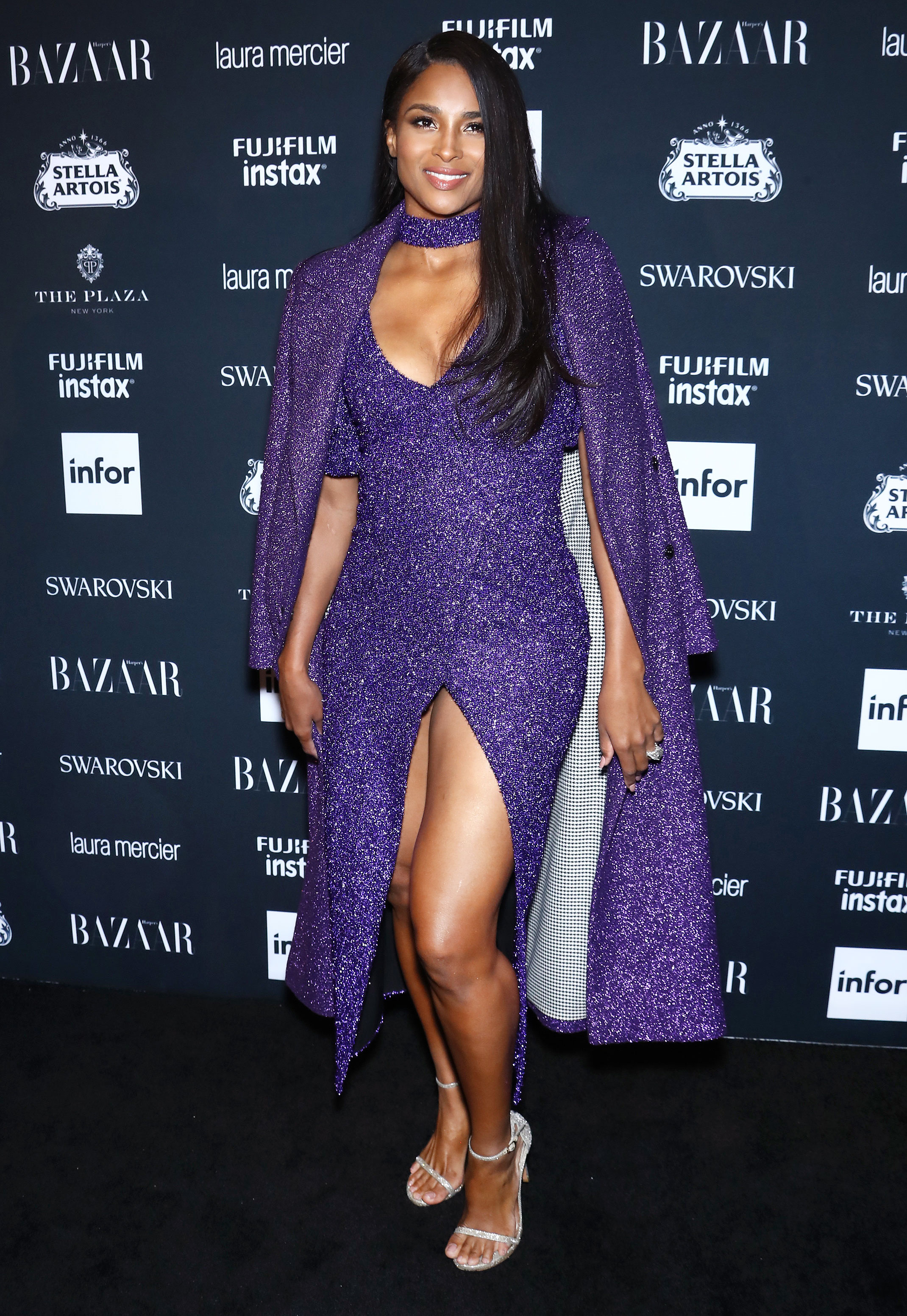 ciara - In a shimmering purple Rasario mididress and coat and Stuart Weitzman shoes at the Harper's Bazaar ICONS party.