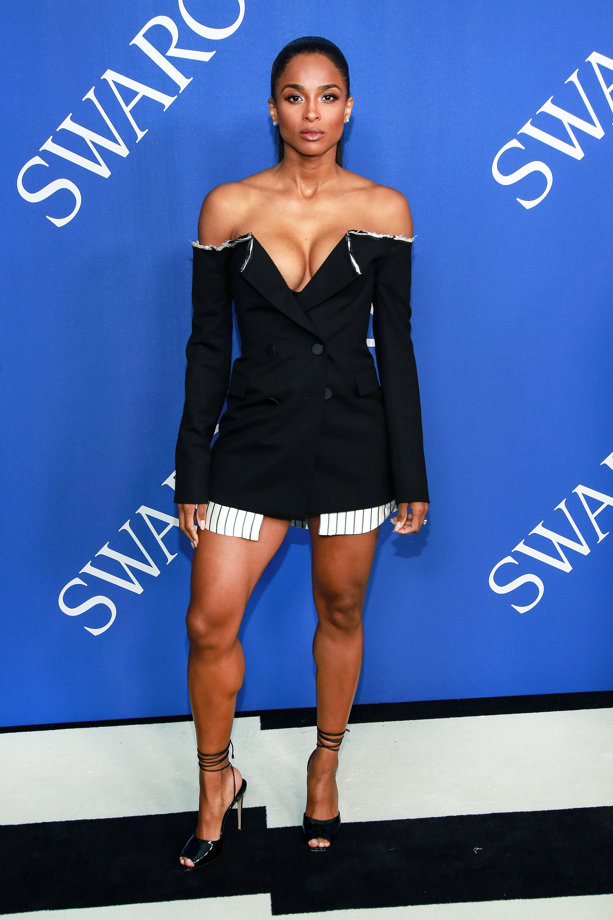 ciara - In a layered wool-blend Monse mini and lace-up Paul Andrew peep-toes at the CFDA Fashion Awards.