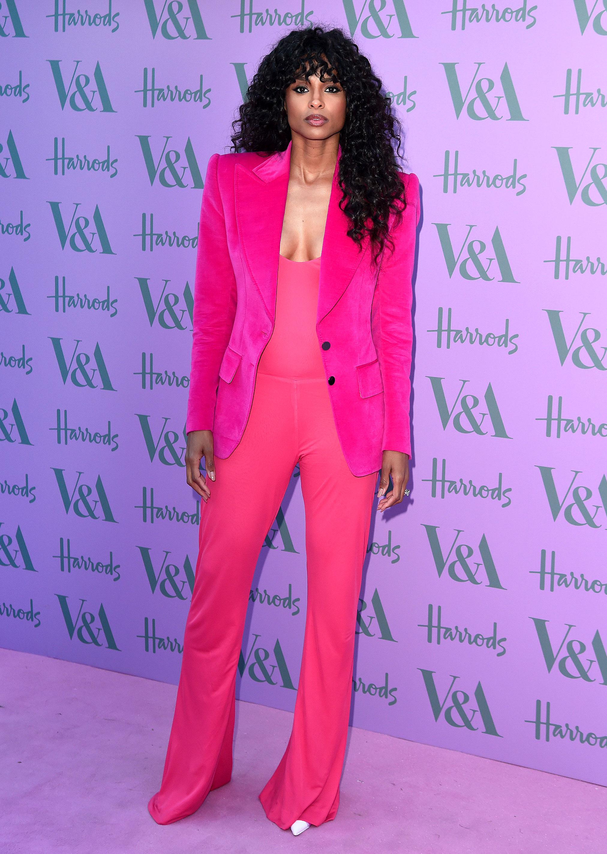 ciara - In a hot pink Tom Ford velvet jacket, jumpsuit and satin kicks at the V&A Summer Party.