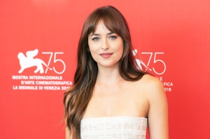 Dakota Johnson Says She's 'Very Happy' With Chris Martin