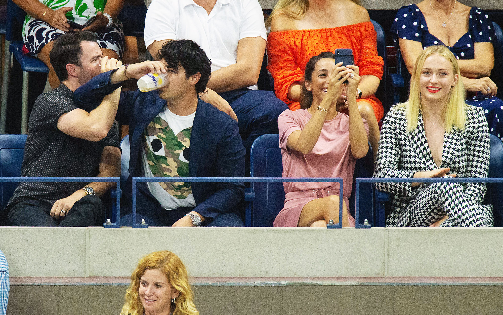 Kevin Jonas Joe Jonas Danielle Jonas Sophie Turner Us Open 2018 - The eldest Jonas Brothers chugged beers while Kevin's wife, Danielle, captured the viral moment and the Game of Thrones actress — who is engaged to Joe — watched with a smile on September 3.