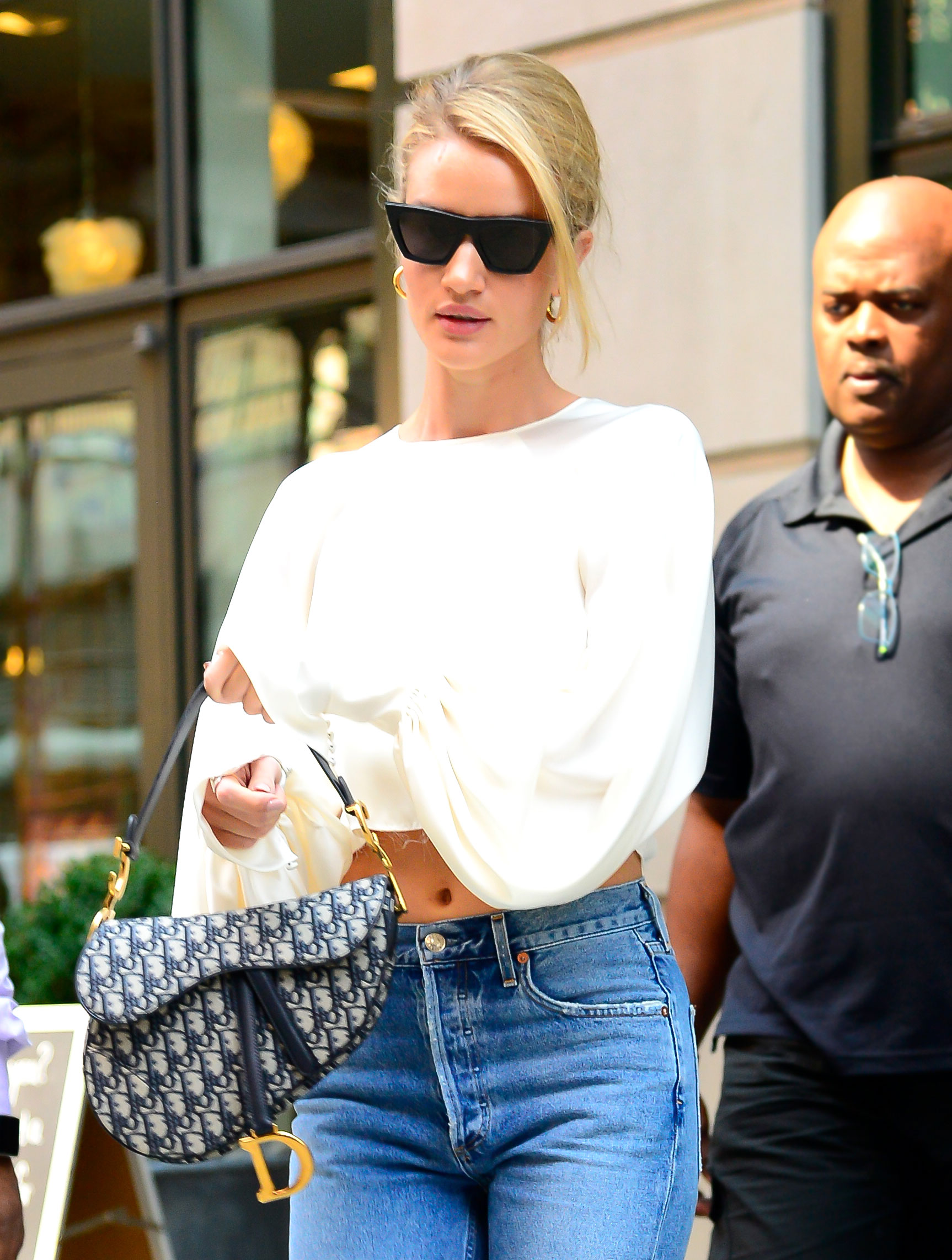 Rosie Huntington-Whiteley - The actress paired her canvas print style with the cool girls' uniform of faded jeans and a white blouse on August 15.