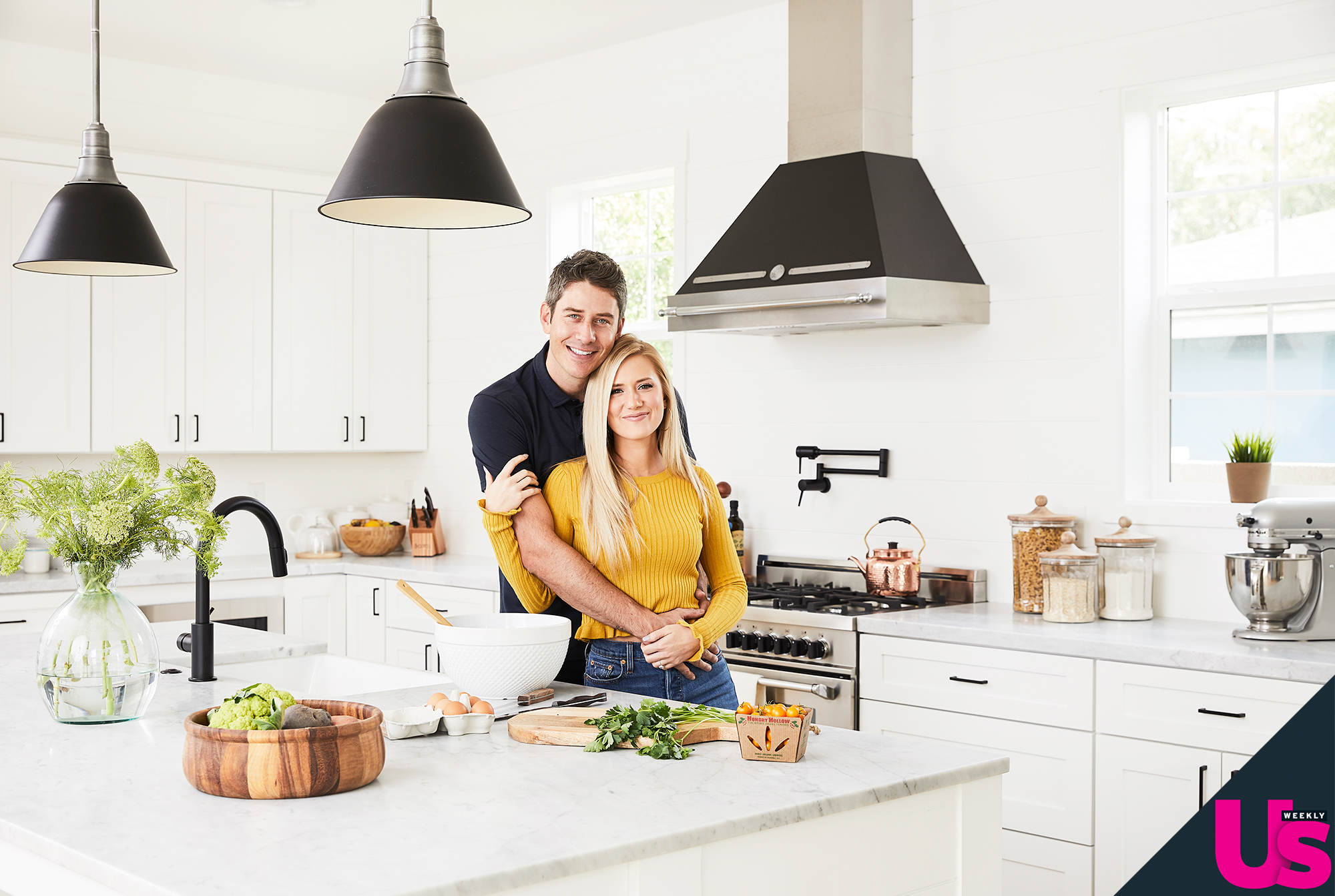 """Arie Luyendyk Jr Lauren Burnham New Home - """"What we love most about our kitchen is the gray marble mixed with the all-white cabinets and shiplap backsplash,"""" the salesperson says."""
