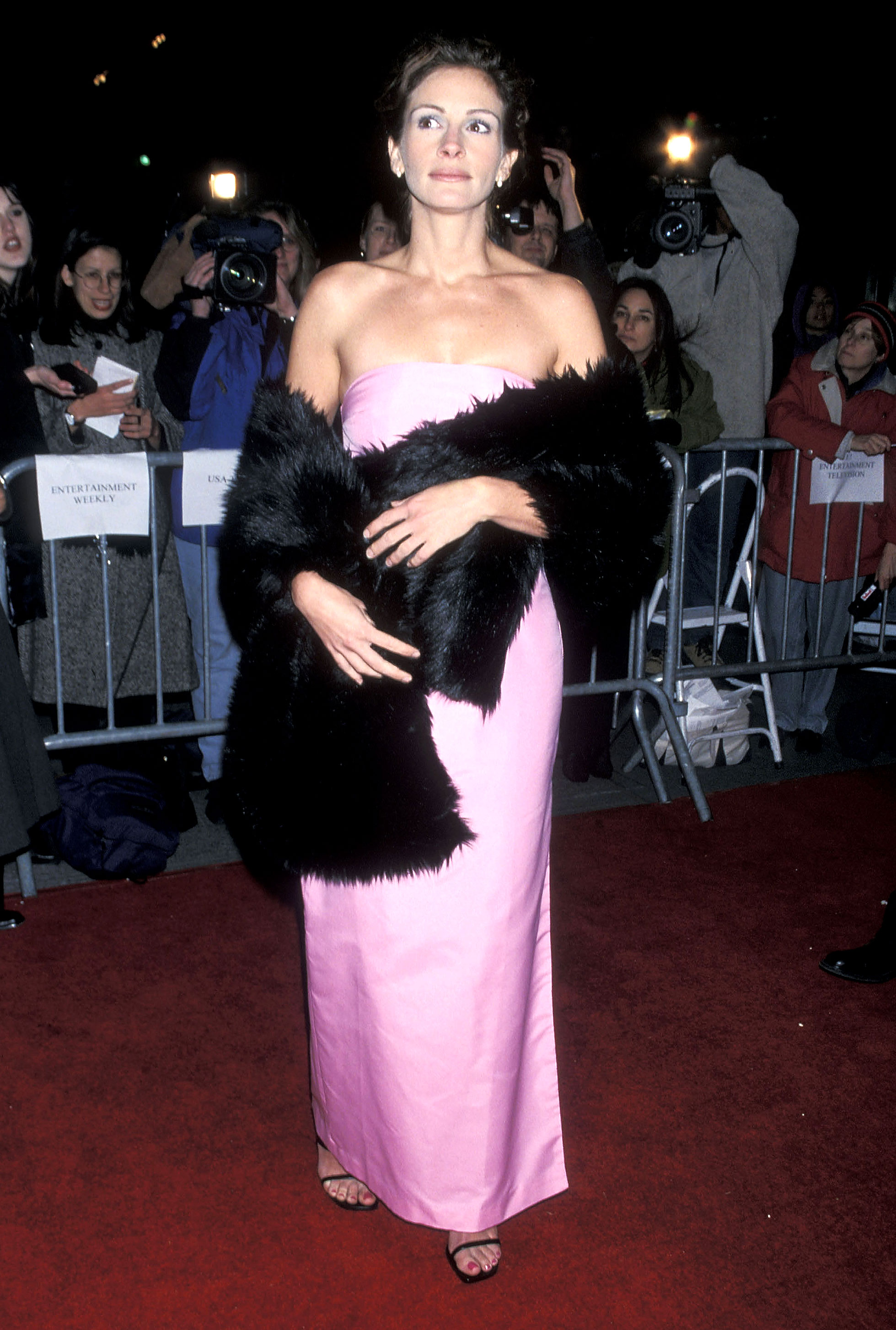 Julia Roberts - In one of her more colorful red carpet moments, the actress opted for a bubblegum pink strapless design and black fur wrap at the 1998 Stepmom premiere in NYC.