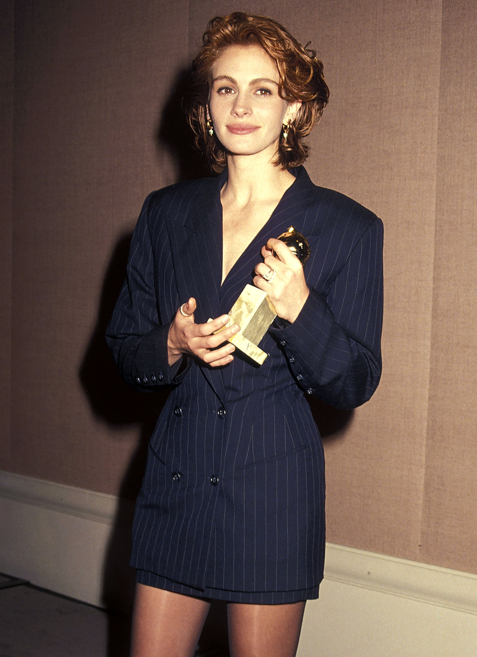 Julia Roberts - The actress showed some leg while picking up her best actress Golden Globe for Pretty Woman in 1991 in a pinstripe skirt suit and sheer stockings.