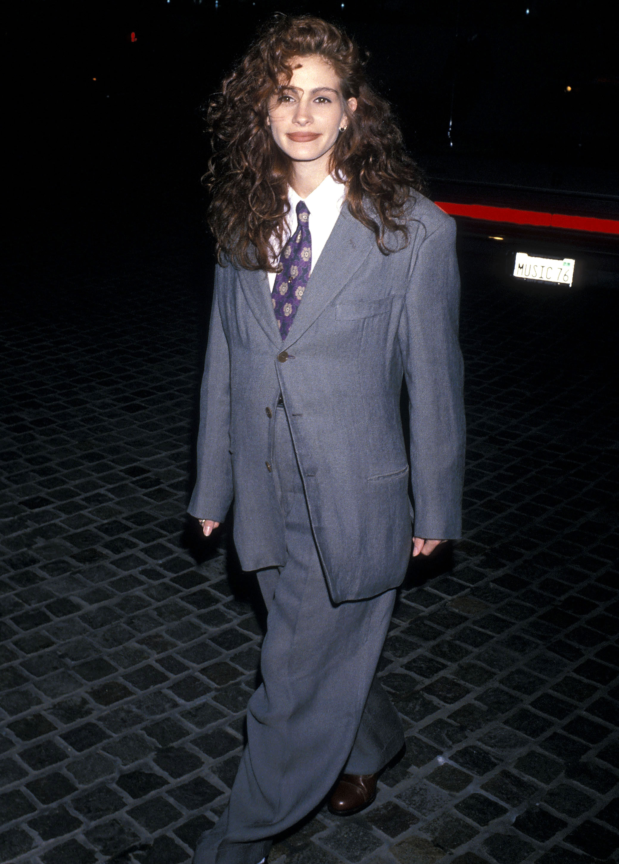 Julia-Roberts-8 - The best accessory for a slouchy, borrowed-from-the-boys Giorgio Armani suit and tie? Cascading curls, as she proved at the 1990 Golden Globes.