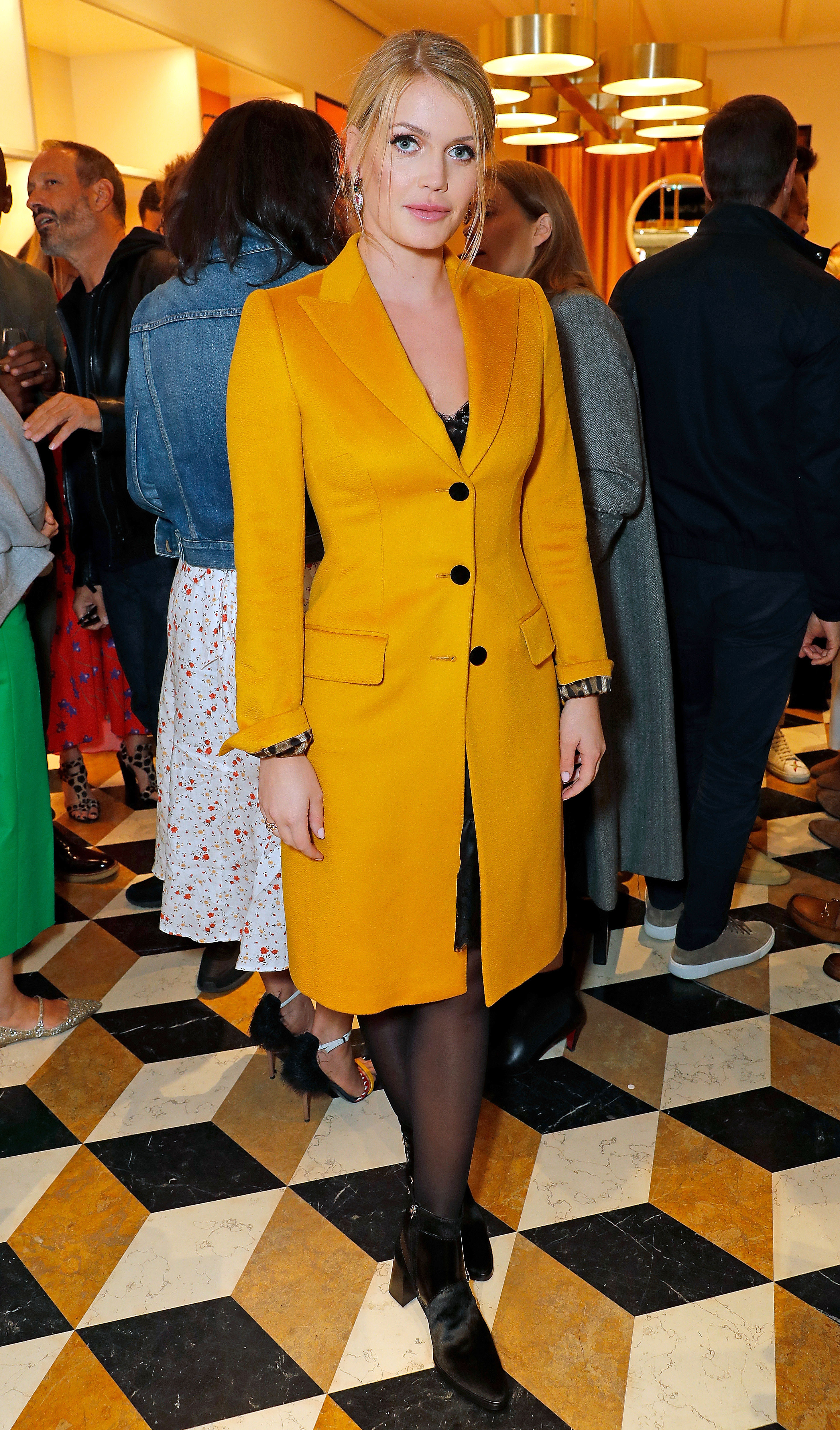 Kitty Spencer Slays Again - At a London Fashion Week party on September 15, 2018, the blonde beauty brightened things up in a canary yellow Dolce & Gabbana coat and Bulgari jewels.