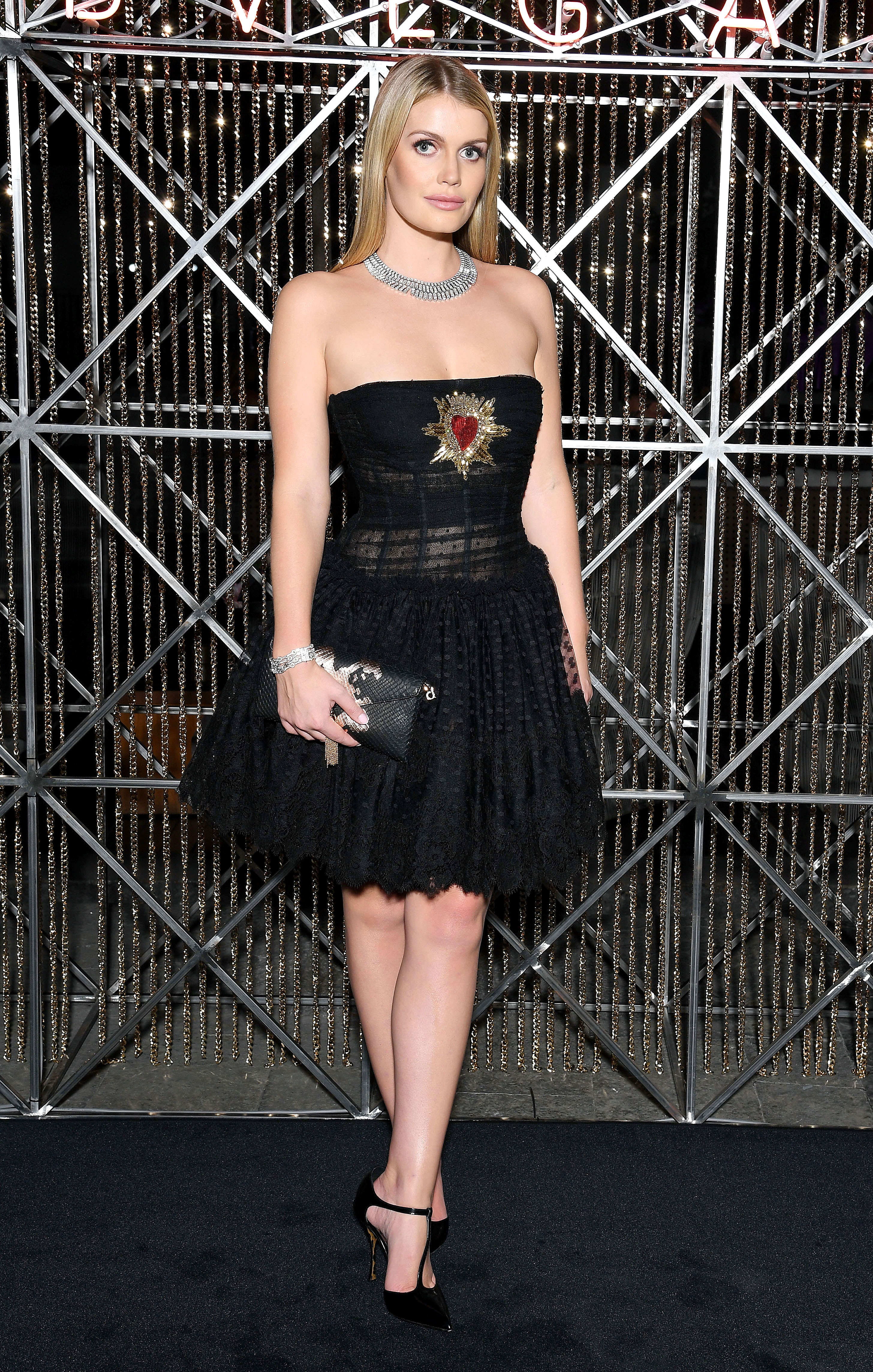 Kitty Spencer Slays Again - The socialite showed some leg in a heart-adorned Dolce & Gabanna mini at a Bulgari event during Milan Fashion Week on September 21, 2018.