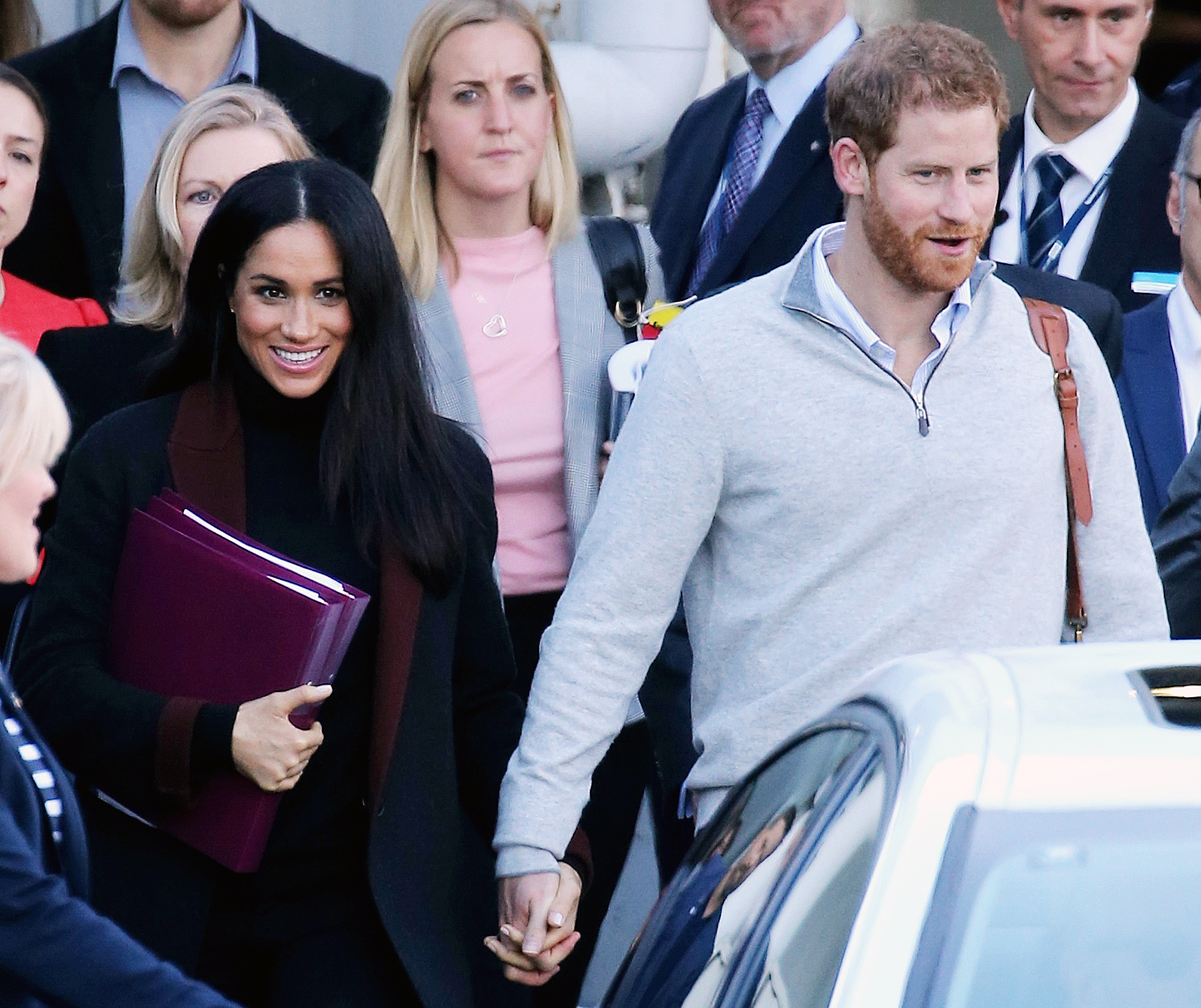 Prince Harry Duchess Meghan Sydney Arrival - The royal couple held hands as they arrived in Sydney after a 24-hour journey to Australia.