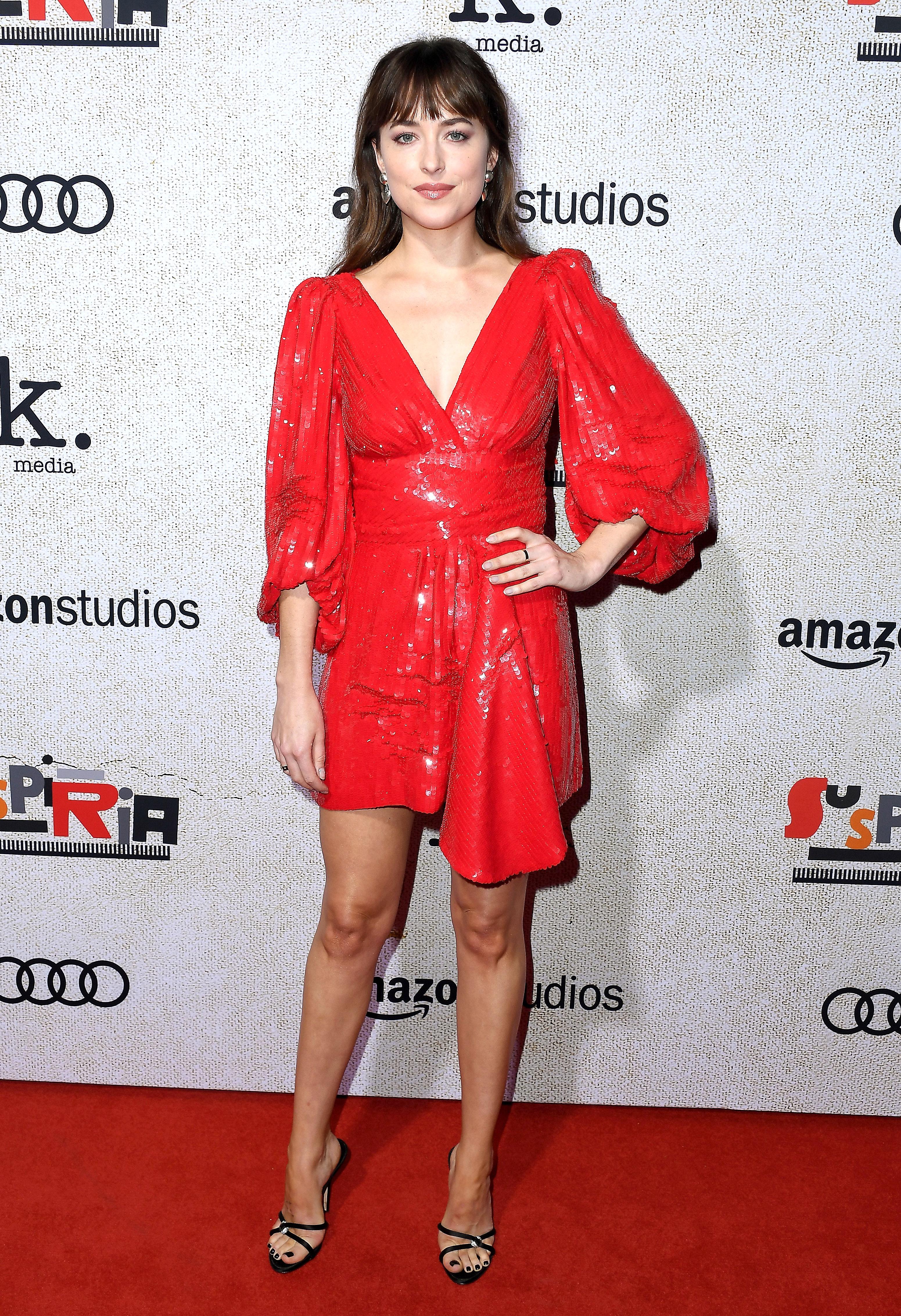 dakota-johnson - In a red sequin Celine by Heidi Slimane minidress.