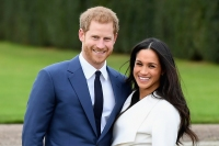Prince Harry (L) and Meghan Markle