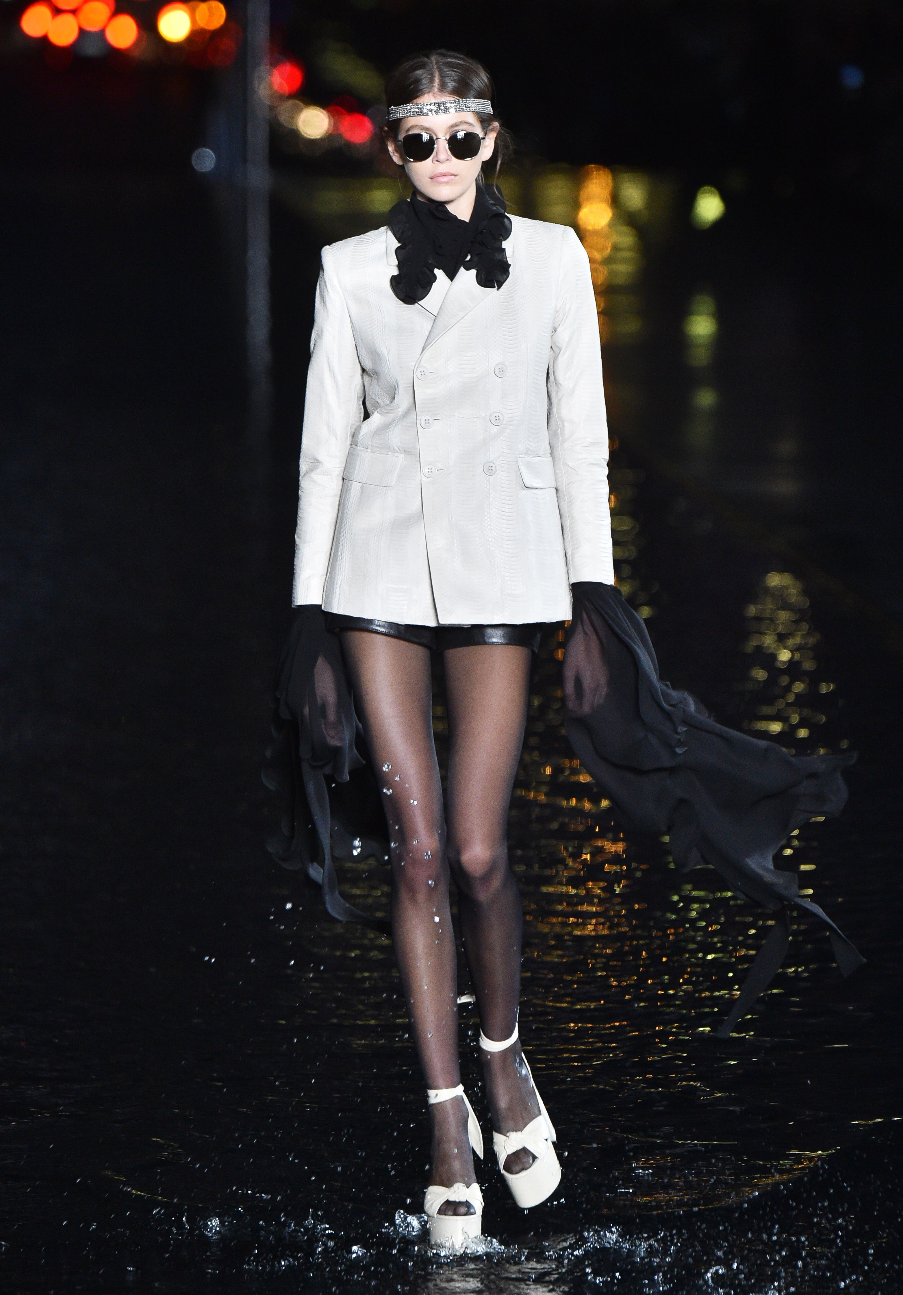 Kaia Gerber - Gerber wore an ivory blazer, a black scarf and vintage-inspired accessories during the Spring-Summer 2019 Saint Laurent show during Paris Fashion Week.