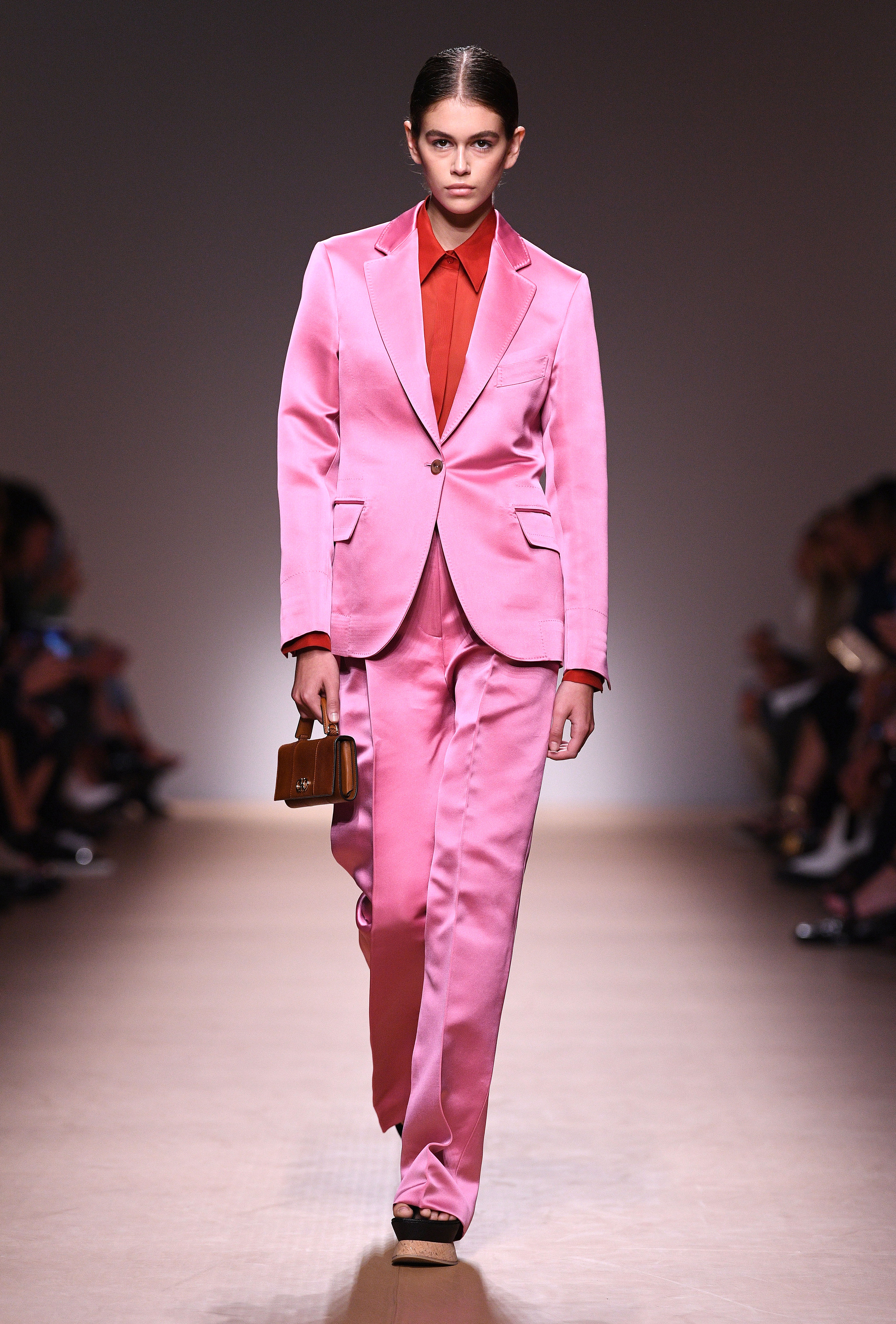 Kaia Gerber - The model worked the Spring-Summer 2019 Salvatore Ferragamo runway in a hot pink suit and a red button-down during Milan Fashion Week.