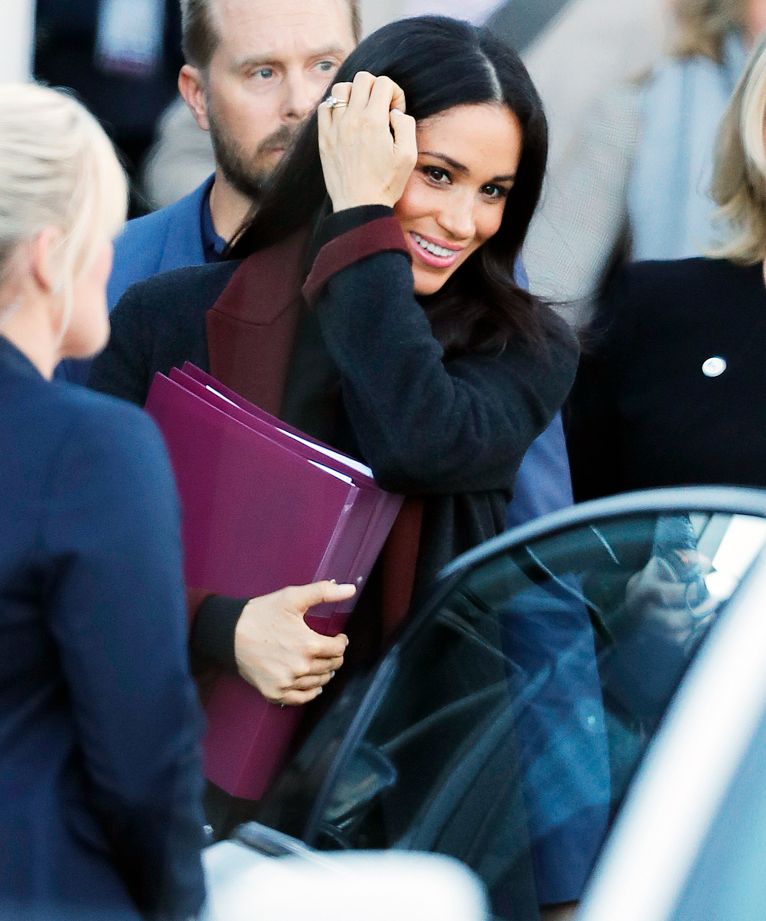 Prince Harry Duchess Meghan Sydney Arrival - Meghan carried folders that likely filled her in on the things she'll be seeing and people she'll be meeting during her first international tour.
