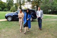 Meghan, Duchess of Sussex (C) arrives with her mother Doria Ragland (L) and Prince Harry, Duke of Sussex
