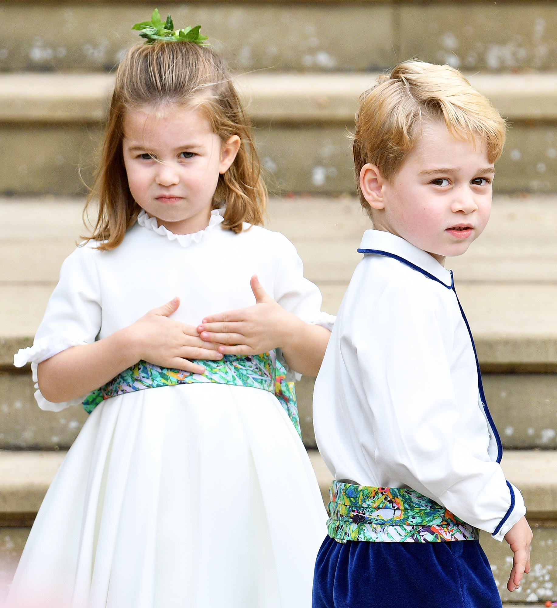 Princess Charlotte Prince George Princess Eugenie Wedding - Princess Charlotte and Prince George were a bridesmaid and pageboy, respectively, in Princess Eugenie's wedding to Jack Brooksbank on October 12, 2018. Three days later, Prince Harry and Duchess Meghan — who were in attendance for the ceremony — announced they are expecting their first child together.