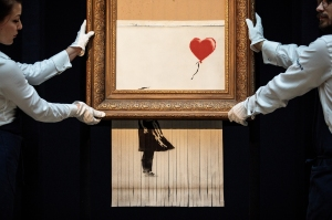 The buyer of the shattered paint Banksy is saving it