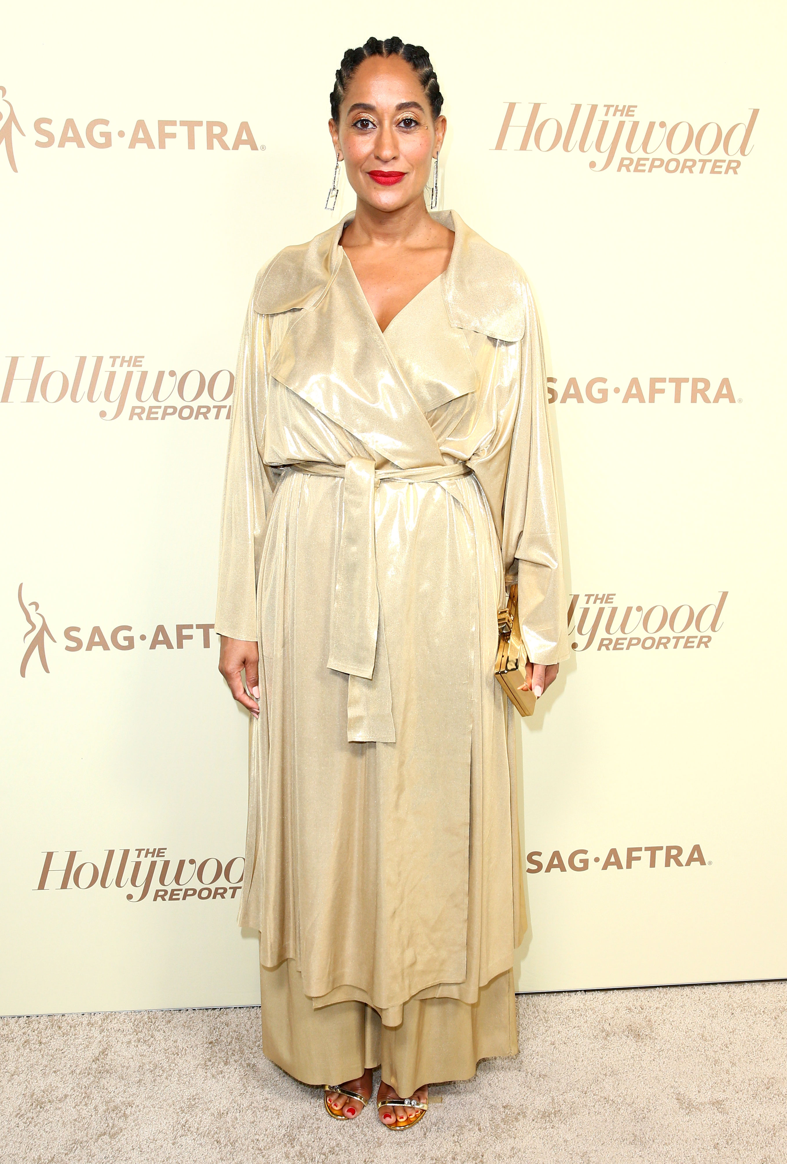 tracee-ellis-ross - At a pre-Emmys bash, the nominee was a golden goddess in a drape-y Norma Kamali pantsuit.