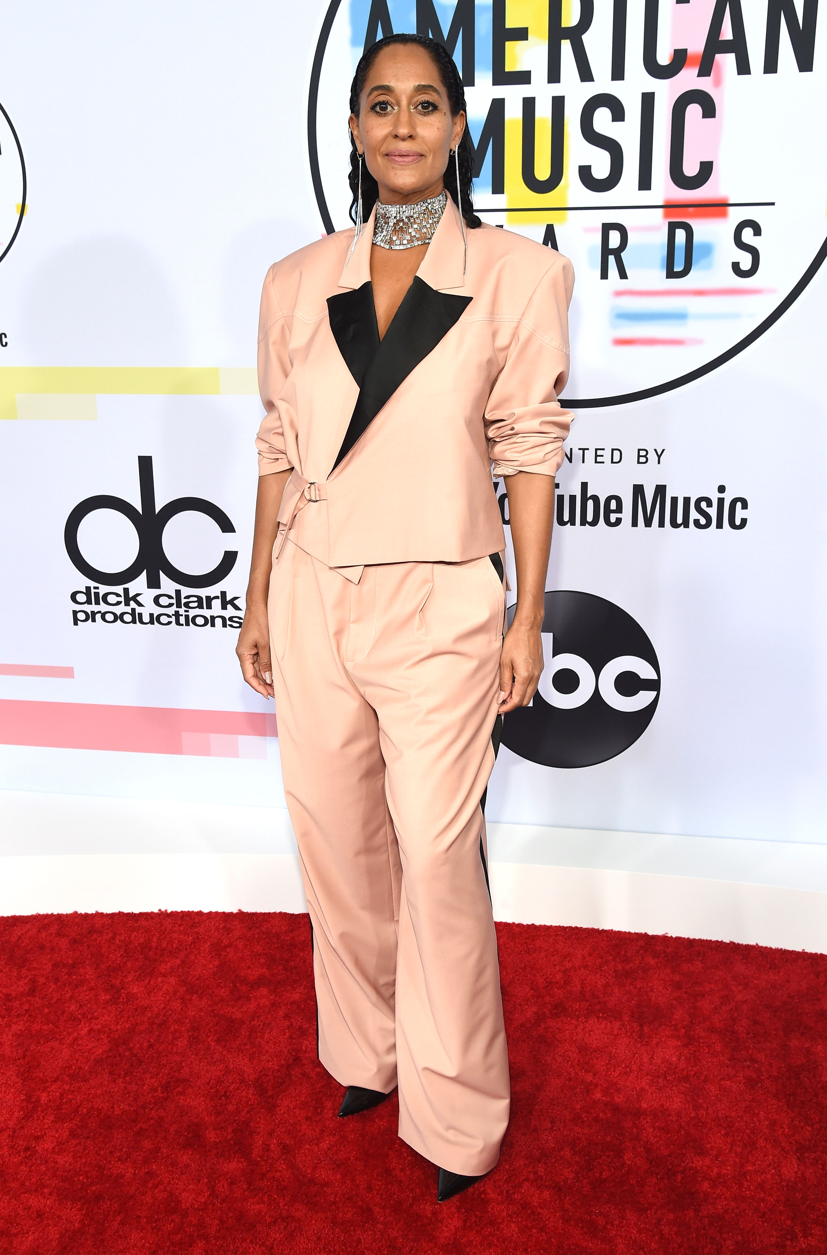 tracee-ellis-ross - Returning as the host of the American Music Awards for the second year in a row, the evening's emcee kicked off her first of 10 (!) outfit changes in a Pyer Moss two-piece, Christian Louboutin pumps, Jacob & Co. necklace and Djula and Mattia Cielo earrings.
