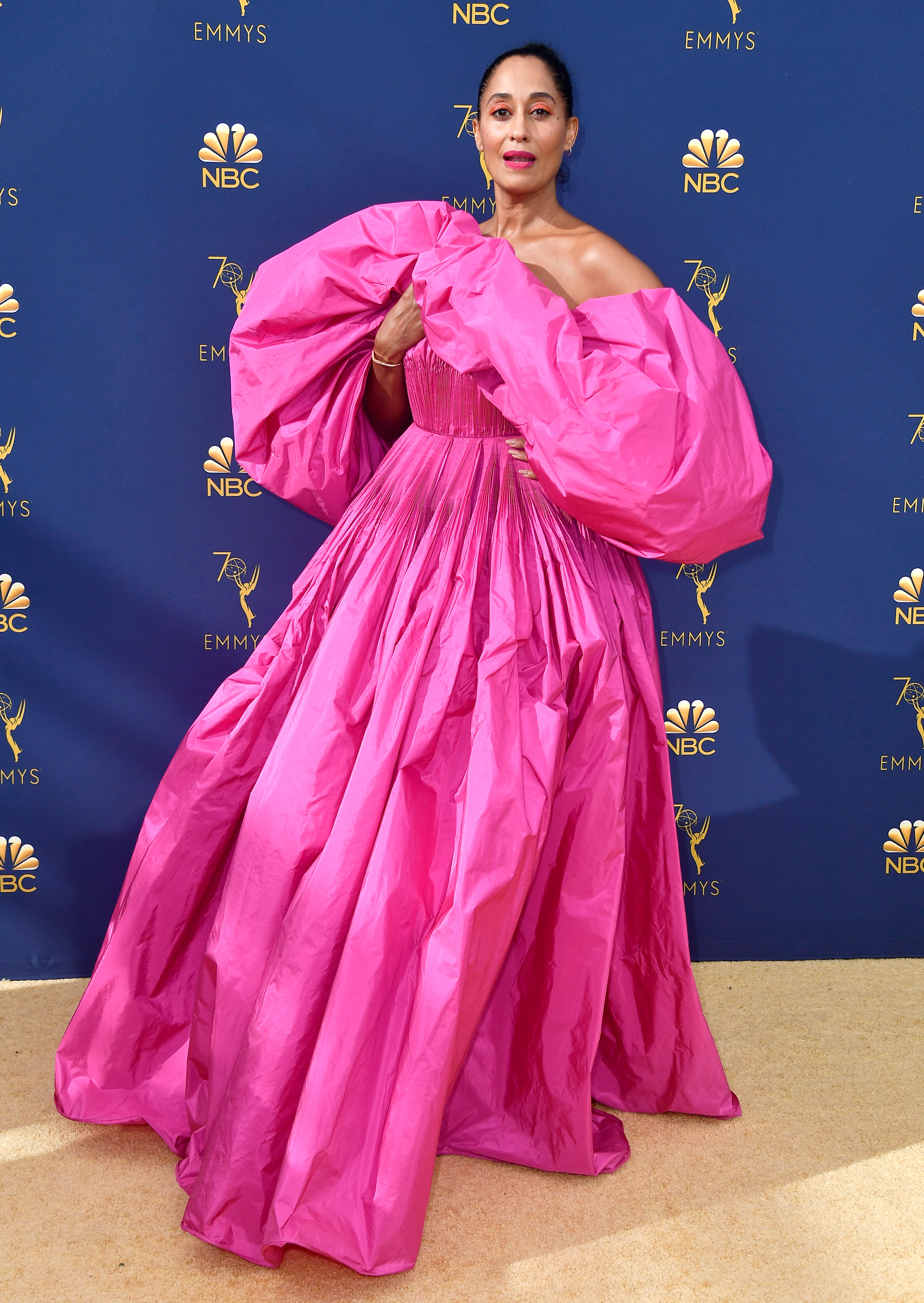 tracee-ellis-ross - The best part of the actress' over-the-top Emmys look? She matched makeup to her voluminous hot pink couture Valentino gown.