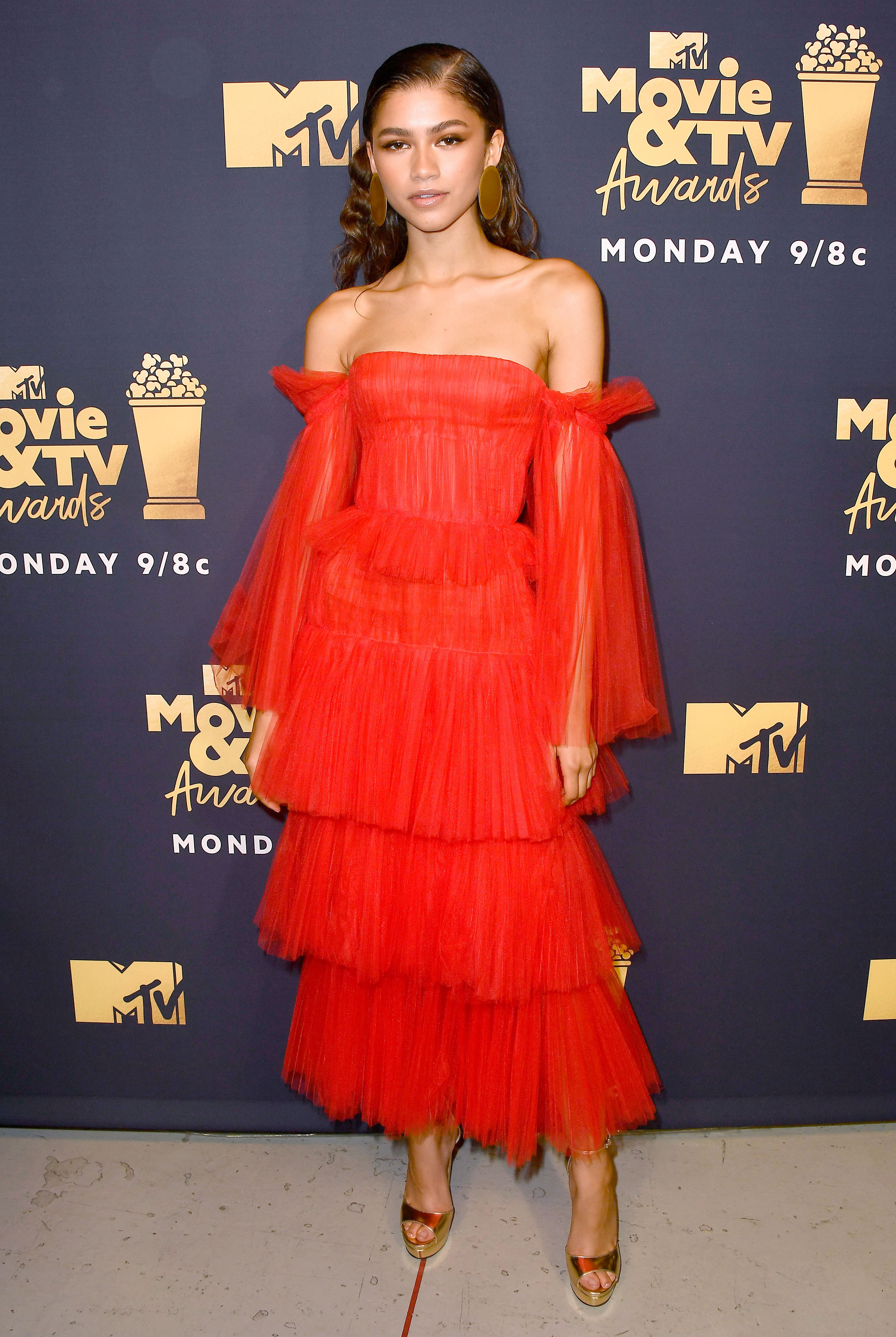 zendaya - In a $4,990 pleated tulle off-the-shoulder number on June 18.