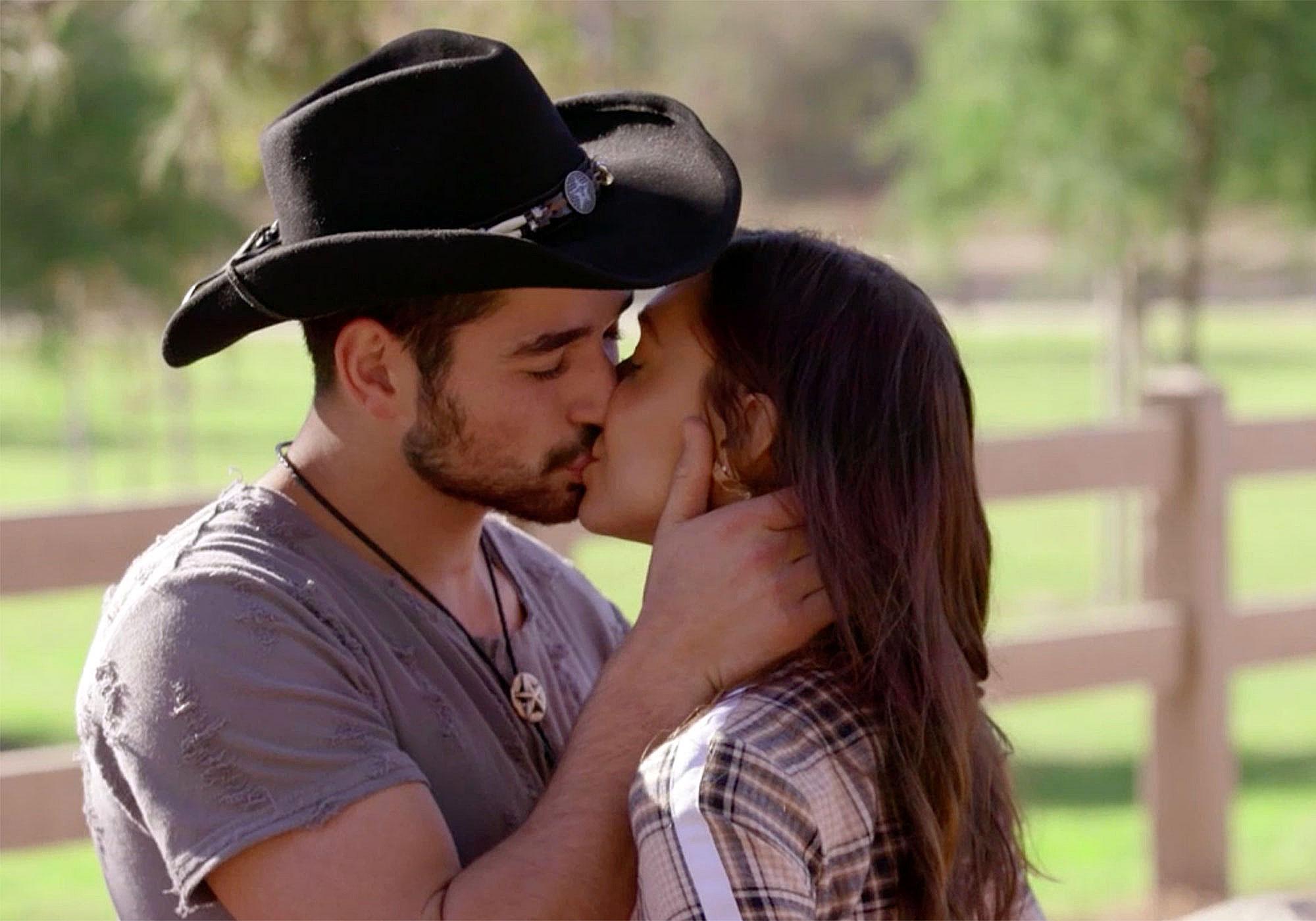 Alan Bersten kisses partner Alexis Ren