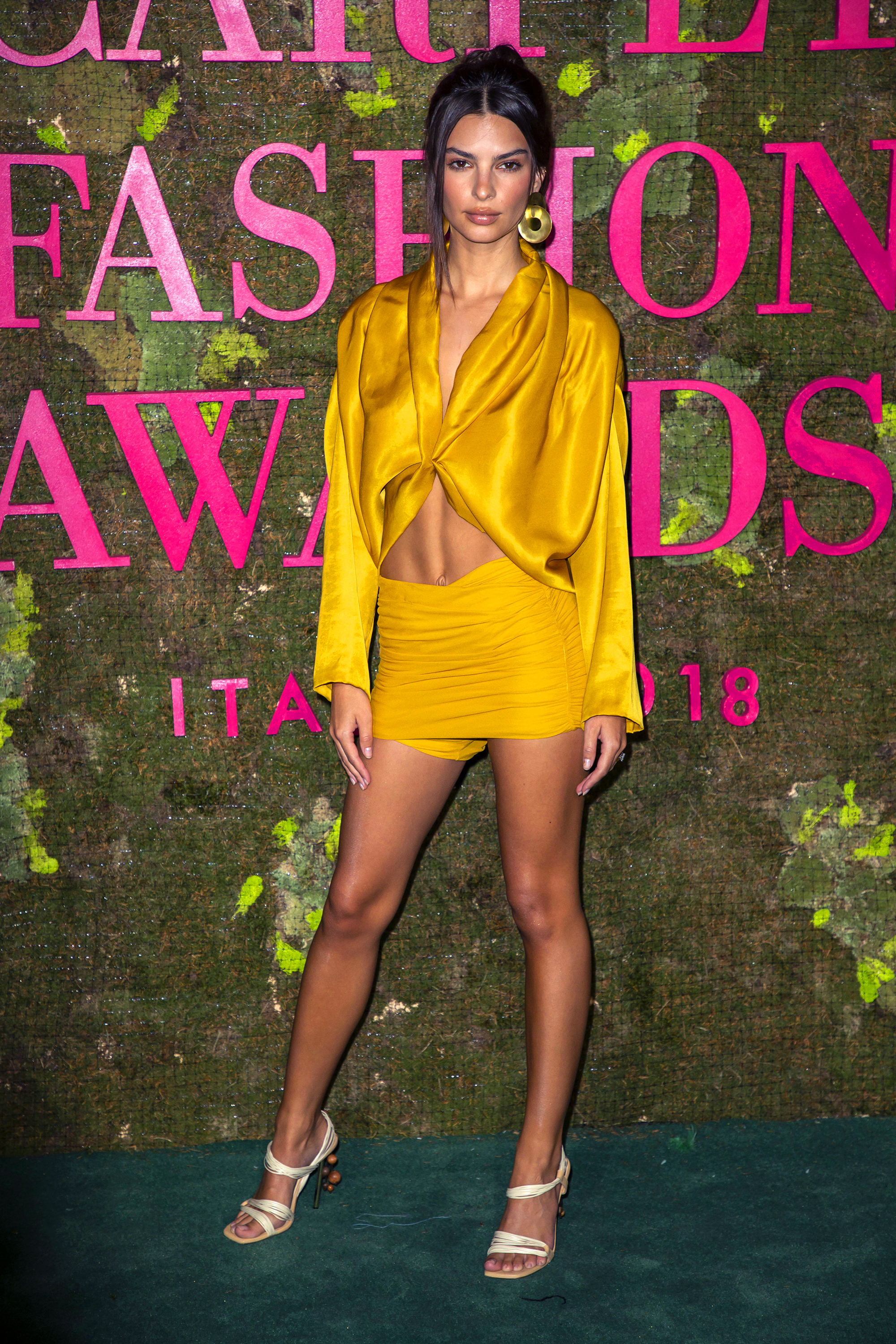 """Emily Ratajkowski abs - The silky marigold ensemble she wore to the Green Carpet Fashion Awards Gala in Milan, Italy perfectly framed her impressive and enviable """"ab crack."""""""
