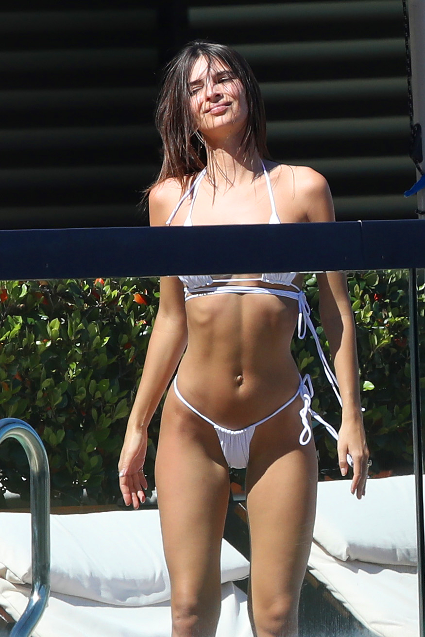 """Emily Ratajkowski abs - On holiday with a friend in Sydney, the I Feel Pretty actress posed poolside in a white bikini. Of healthy drinks, she told the New York Times in 2015, """"I do love turmeric and beet juices. It's so L.A., you can't avoid it."""""""