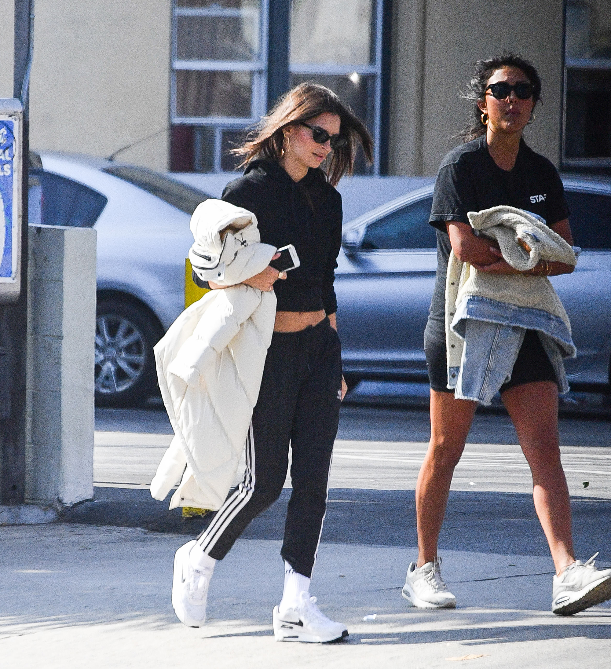 """Emily Ratajkowski abs - """"I don't have a trainer, and I don't really go to the gym. I go on long walks and hikes with my girlfriends,"""" EmRata, with a friend in L.A., also told the Times . """"I'm just not a crazy fitness person. I'm definitely an outlier in the industry."""""""