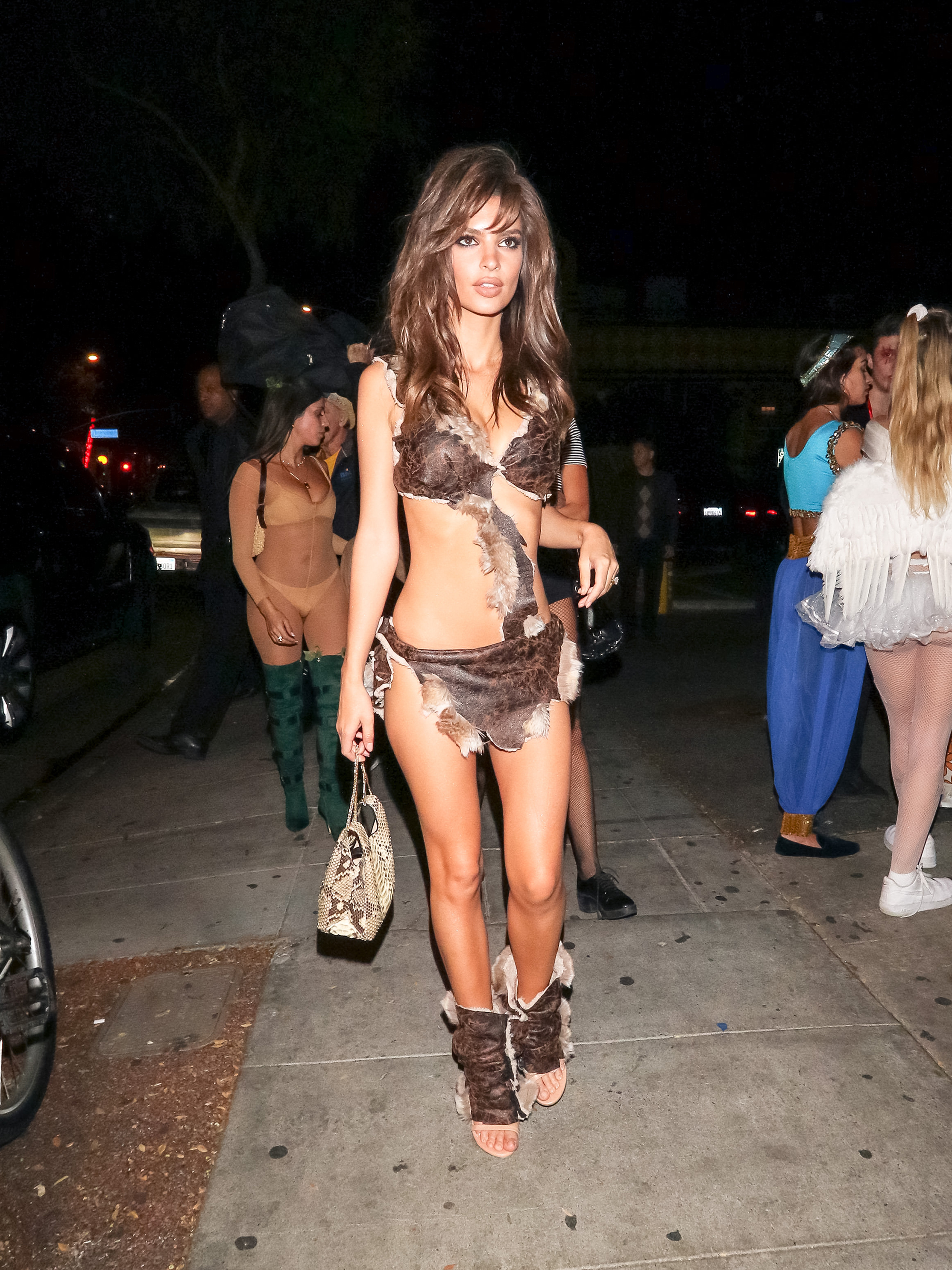 Emily Ratajkowski abs - Have abs, will costume. Ratajkowski went as Raquel Welch's scantily clad character in 1966's One Million Years B.C. for Halloween.