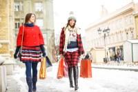 Two happy girls walking down the street