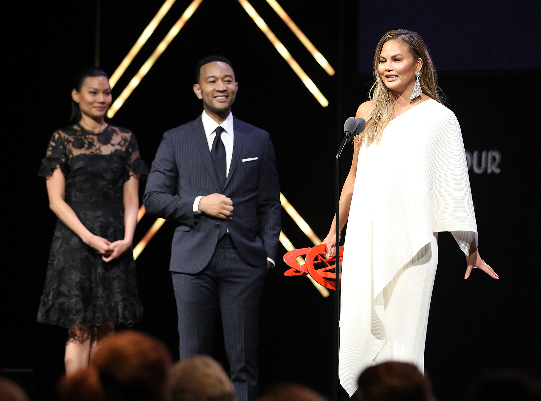 "John-Legend-and-Chrissy-Teigen-Glamour - After Legend heaped praise on Teigen in his presentation of her Glamour Women of the Year Award in November 2018, she replied in kind, calling him ""the most incredible husband on the planet"" during her acceptance speech. But then she caught herself, quipping, ""This is so sappy. I'm sorry. I hate you, John. I really do."""