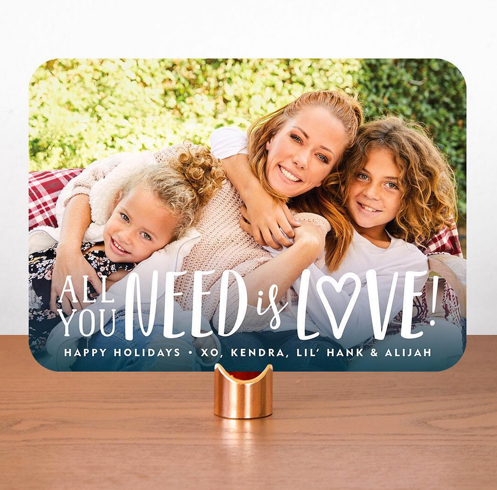 Kendra-Wilkinson-holiday-card - The former Playboy model, who split from husband Hank Baskett in April, is all smiles alongside son Hank IV, 8, and daughter Alijah, 4.