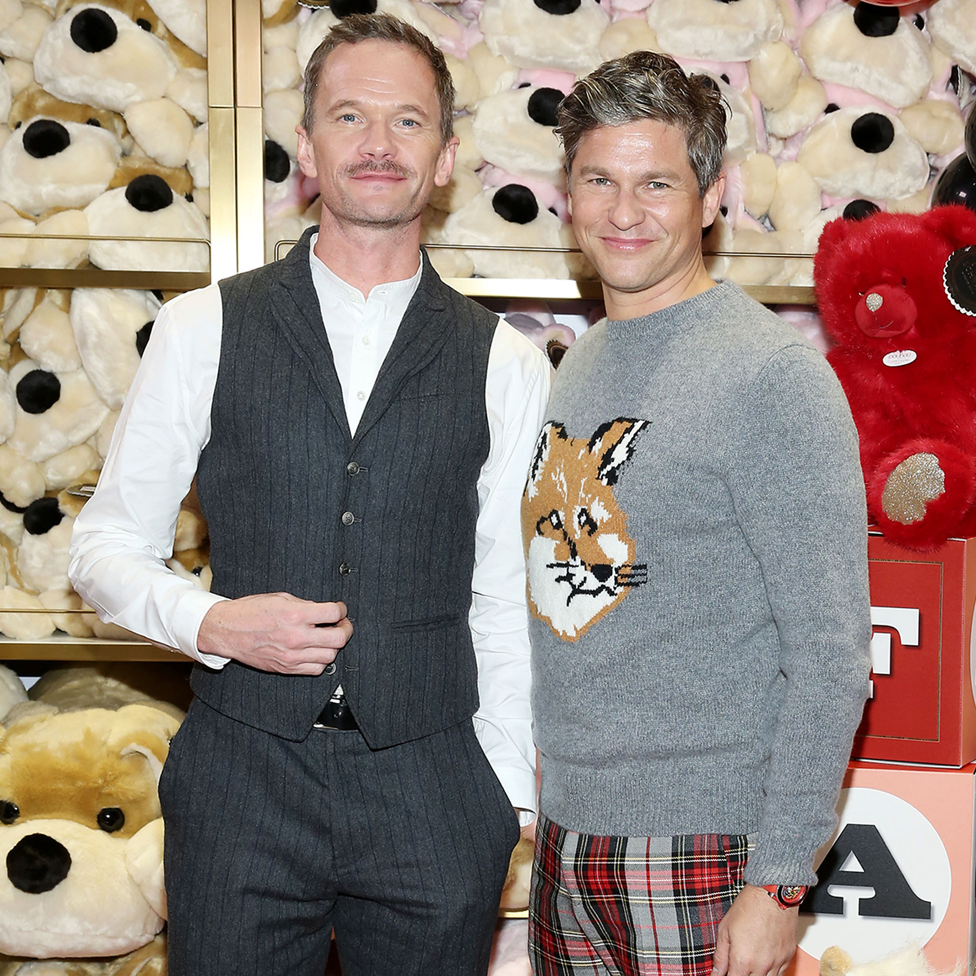 Santa's Naughty or Nice List - NEW YORK, NEW YORK – NOVEMBER 15: Neil Patrick Harris (L) and David Burtka attend the FAO Schwarz Grand Opening Event at Rockefeller Plaza on November 15, 2018 in New York City. (Photo by Monica Schipper/Getty Images)