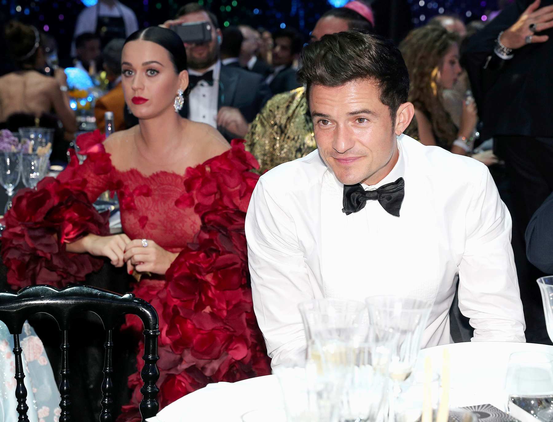 amfar katy perry orlando bloom - After Us confirmed that the pair were hooking up, they tried to avoid being spotted together inside the amfAR Gala during the Cannes Film Festival in France. They even went so far as to sit at different — but adjacent — tables.