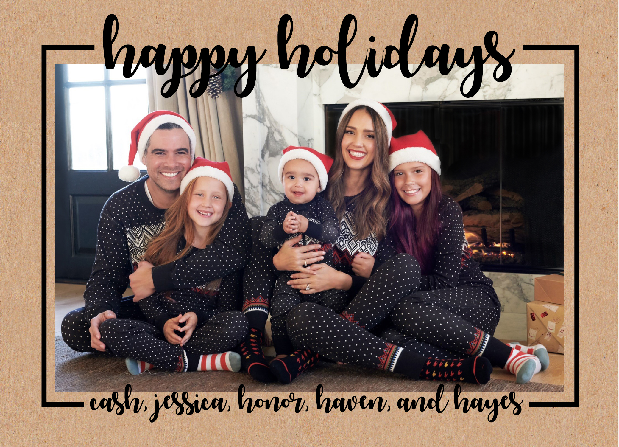 jessica-alba-holiday-card - A family that matches together, stays together! Alba and her little ones with husband Cash Warren — daughters Honor, 10, Haven, 7, and son Hayes, 10 months — cozied up in onesies and Santa Claus hats to ring in the holiday season.