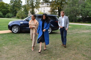 Meghan, Duchess of Sussex (C) arrives with her mother, Doria Ragland (L) and Britain's Prince Harry