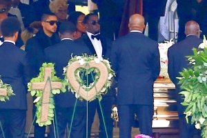 Sean Combs at Kim Porter's graveside.