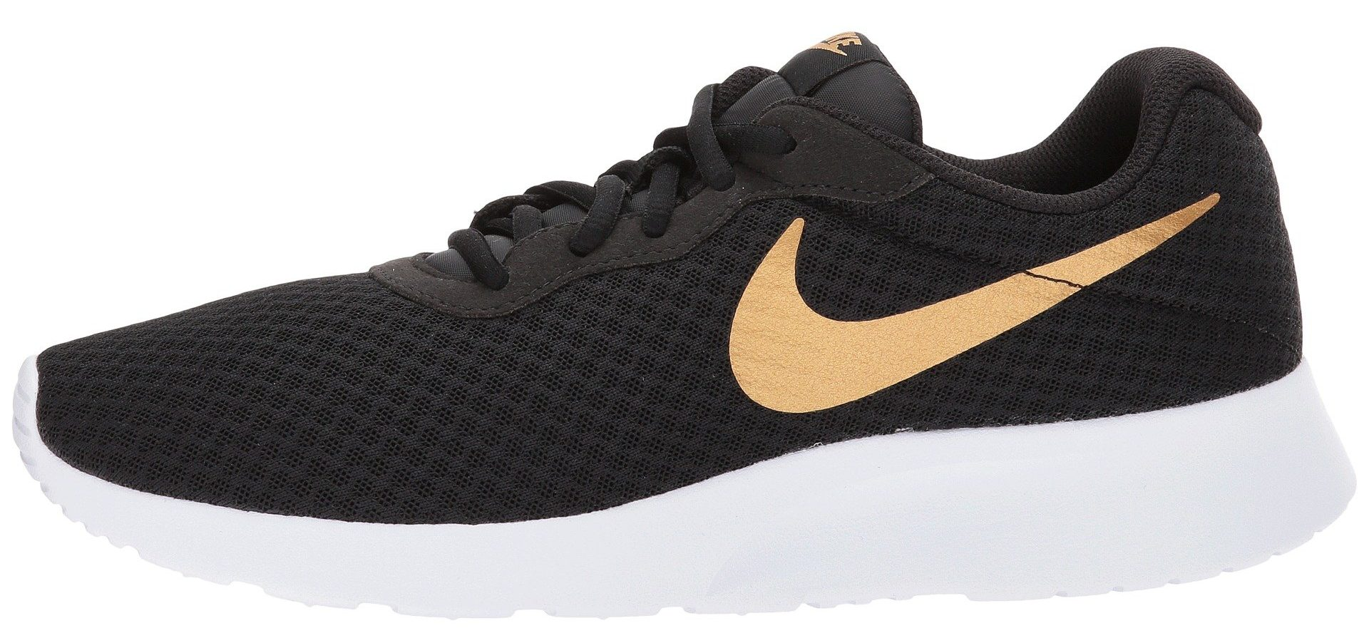 white black and gold nike sneaker