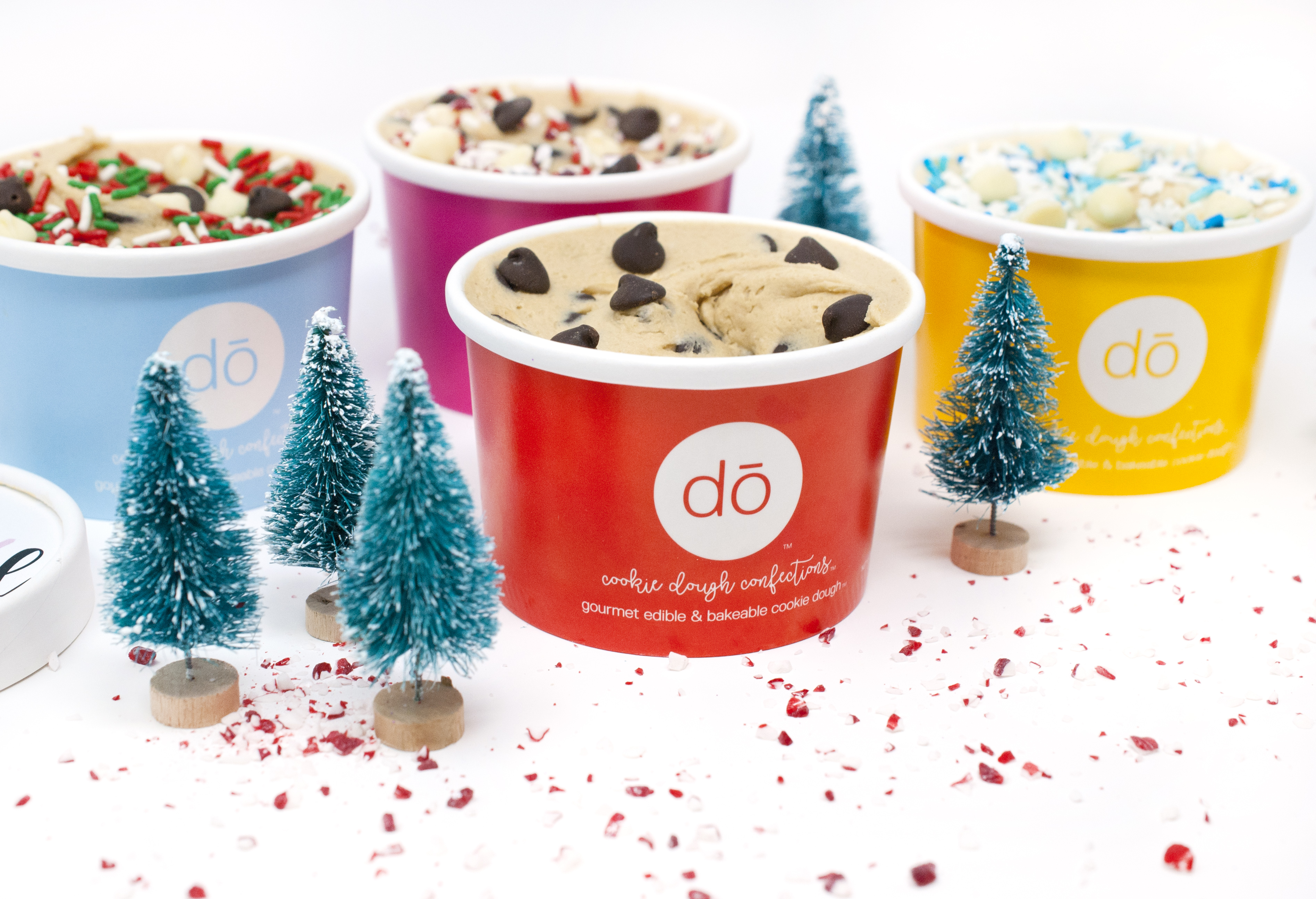 1 DŌ Cookie Dough Confections Naughty and Nice Gift Packs - It's hard to hop on Instagram without seeing edible cookie dough on your feed, and this holiday season the company that started it all — DŌ — released The Naughty List and The Nice List bundles. Each four-pack gift set includes different varieties of safe-to-eat raw cookie dough in festive flavors including signature chocolate chip, holiday cake batter, peppermint bark and winter wonDŌland.