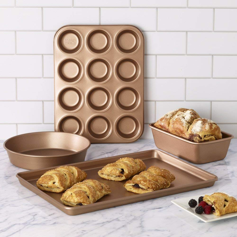 """17. Chicago Metallic Elite Bakeware Collection in Rose Bronze - If 2018 was all about rose gold, then 2019 is going to be all about rose bronze. The hue is the focal point of Chicago Metallic Elite Bakeware's latest collection, which includes a 9"""" round cake pan, 9"""" pie pan, 9"""" square pan, 9""""x5"""" loaf pan, 13"""", 15"""" and 17"""" jelly roll pans, 9""""x13"""" cake pan and a 12-cup muffin pan."""
