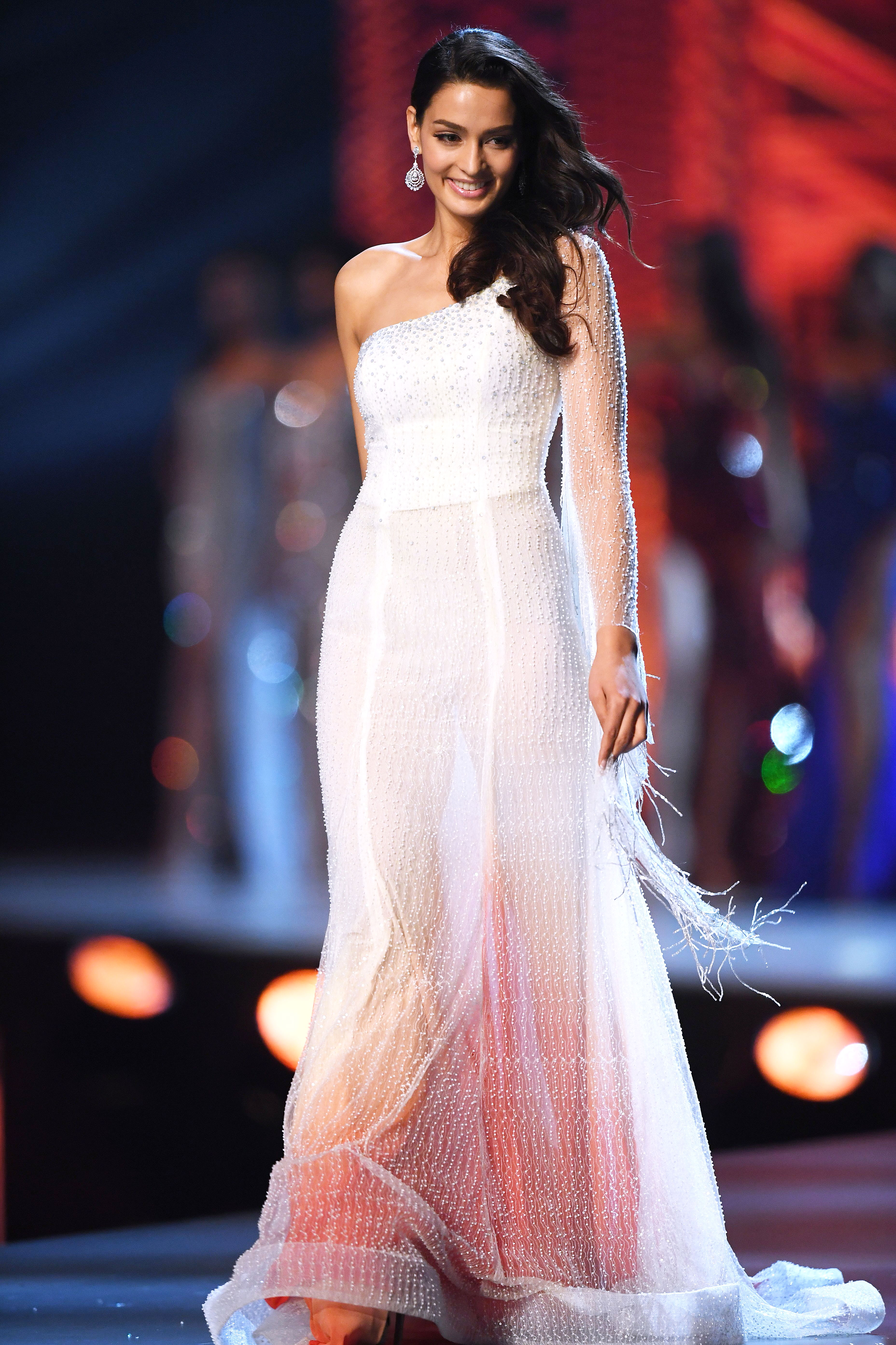 1_Miss-Nepal-Manita-Devkota-miss-universe - In a single-sleeve white dress featuring feathered and beaded accents.