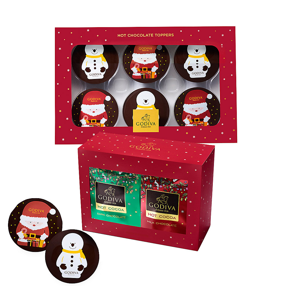 21. Godiva Holiday Hot Chocolate Toppers - Instead of gifting a box of chocolates, why not show up bearing some adorable holiday-themed hot chocolate toppers? Made with the finest dark chocolate, these cute creations are sold in a set of six and are decorated with the image of a Santa or snowman.