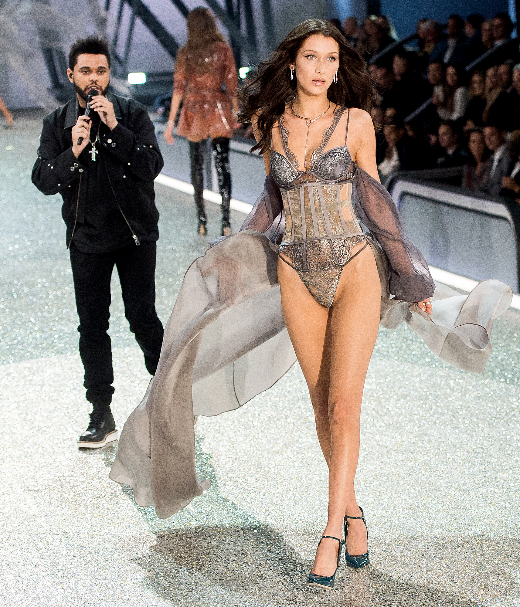 "3-Showing-Him-What-He's-Missing-bella-hadid-the-weeknd - Following their split, Hadid slayed the runway at the Victoria's Secret Fashion Show in Paris in November 2016 while The Weeknd performed. The pair remained professional, but the proof was in his set: the ""I Can't Feel My Face"" singer couldn't keep his eyes off his ex."