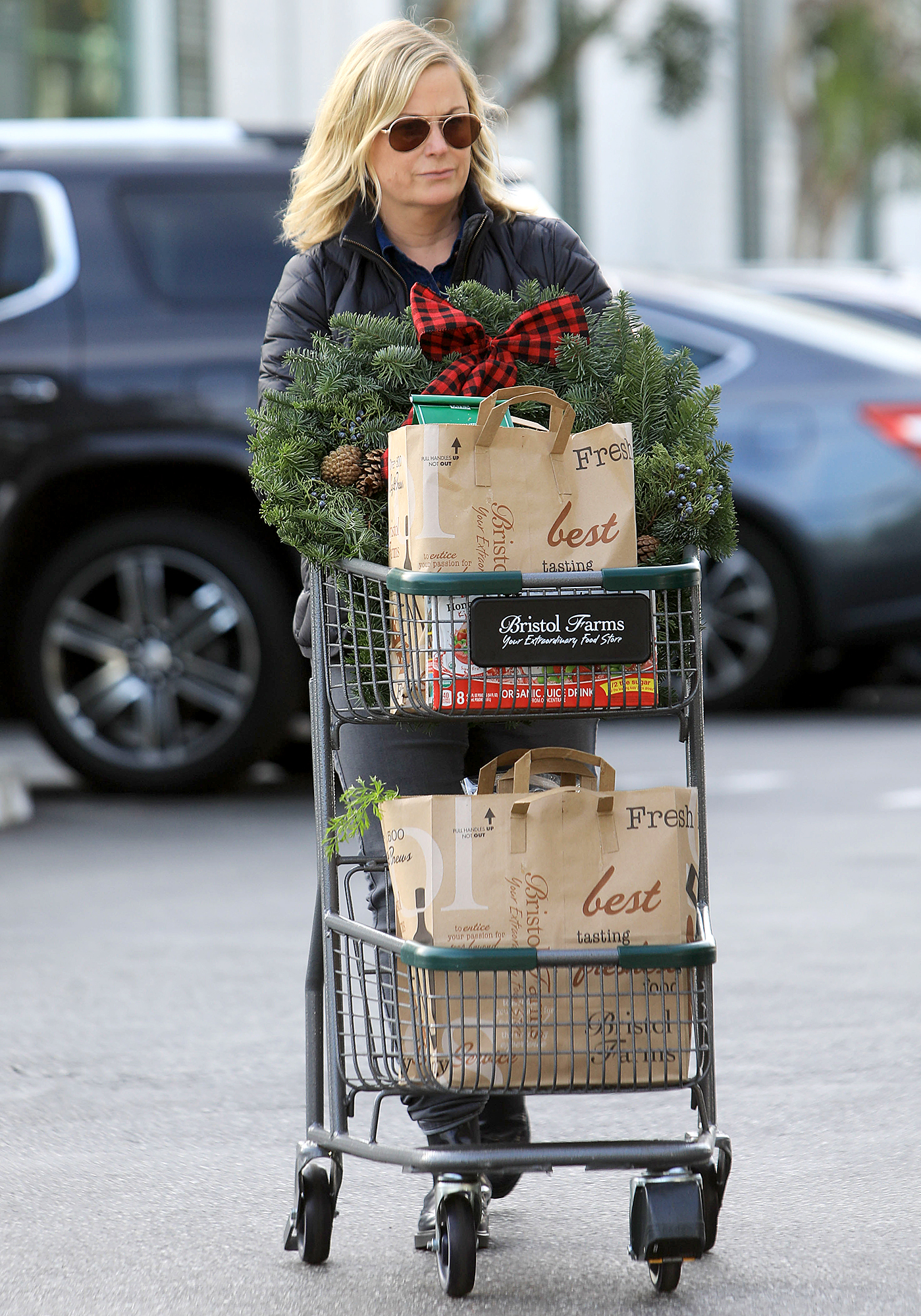 """Amy-Poehler christmas shopping - """"I can remember around [the age of] 10, defending the idea of Father Christmas in the playground,"""" Amy Poehler says of her holiday spirit (pictured in Beverly Hills, November 27)."""